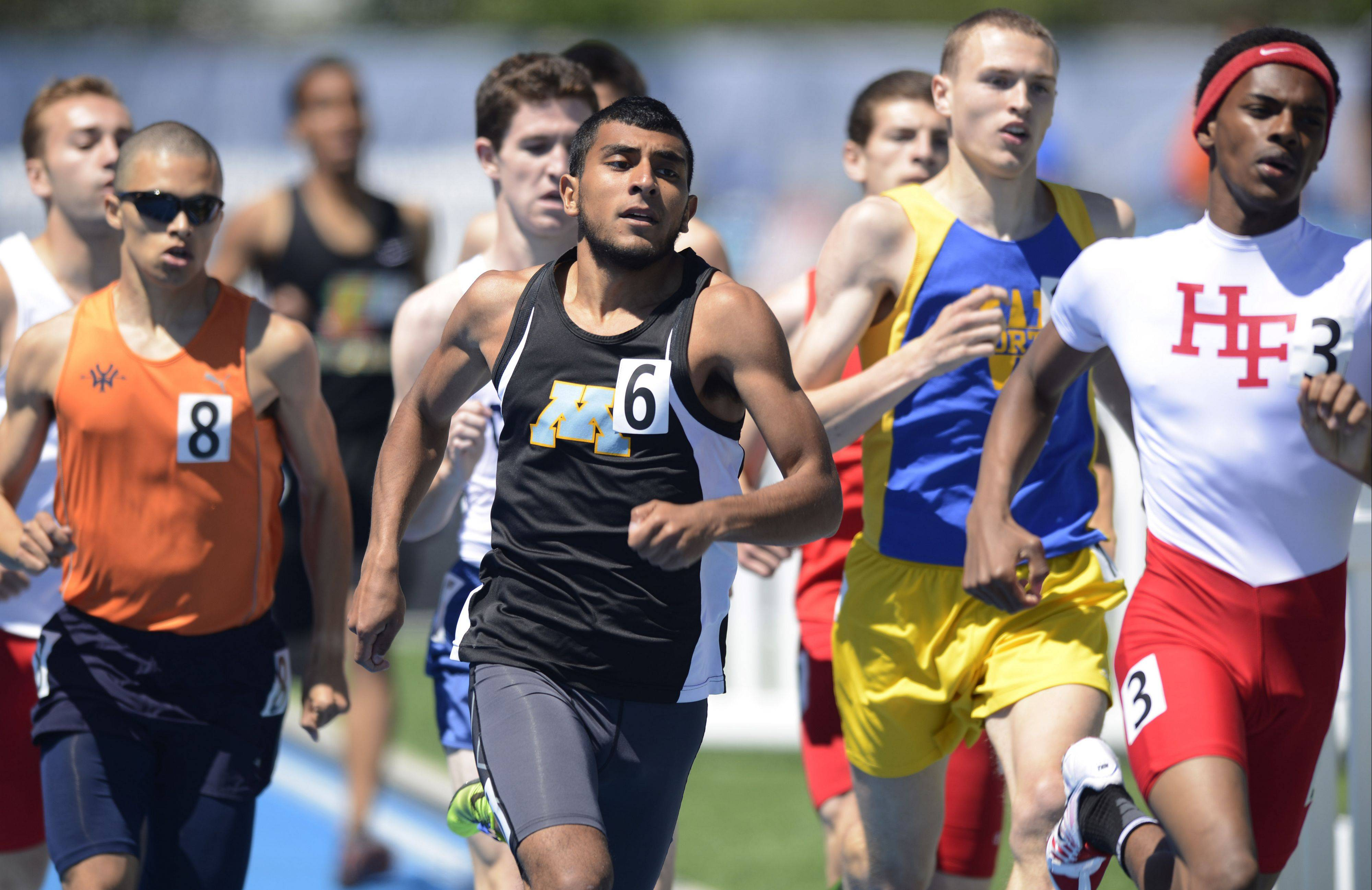 Maine West's Alex Gasca, middle, competes in the Class 3A 800-meter run during the boys track state meet preliminaries in Charleston on Friday.