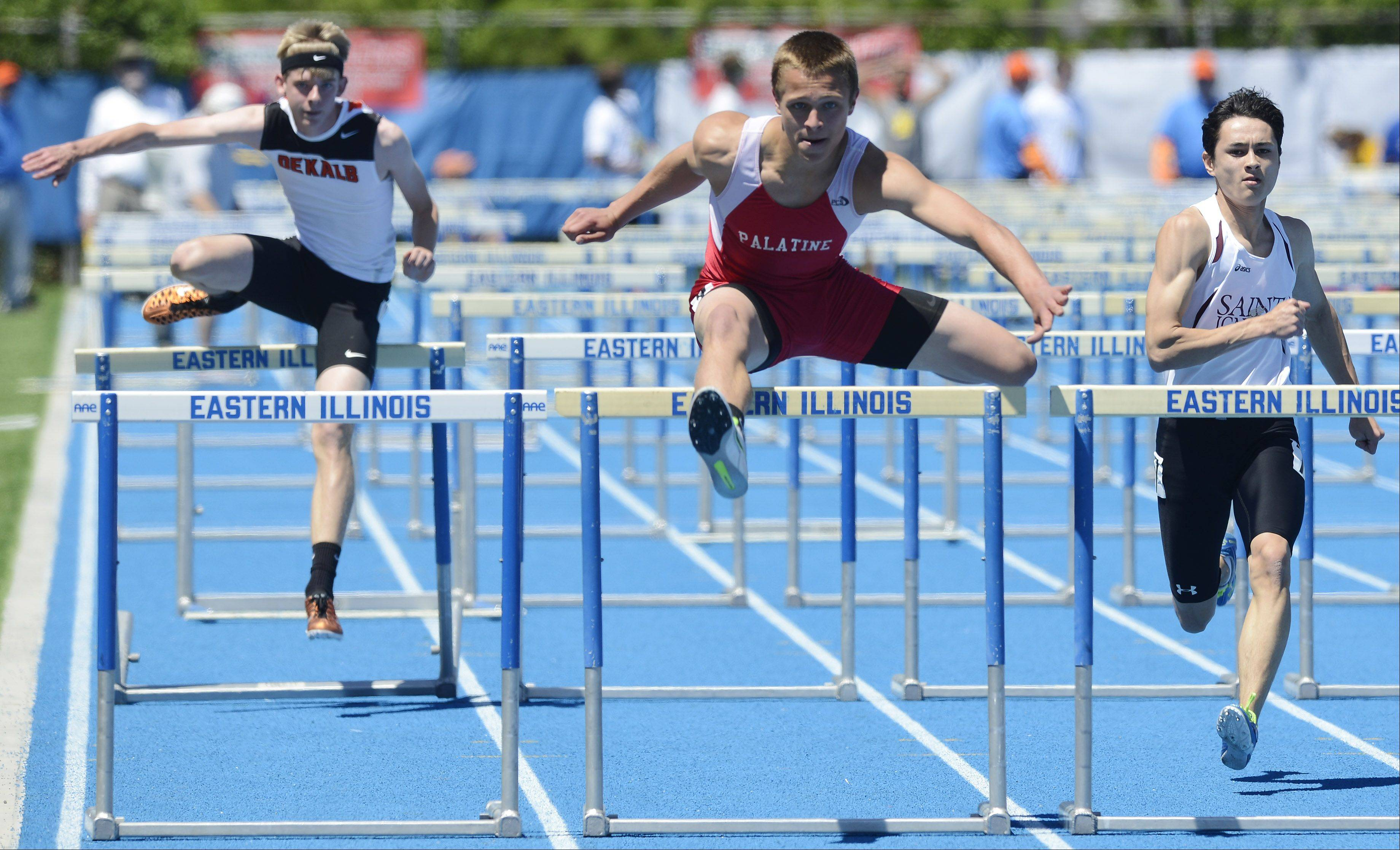 Palatine's Cam Kuksa, middle, clears the final hurdle in the 110-meter high hurdles during the boys track state meet preliminaries in Charleston on Friday.