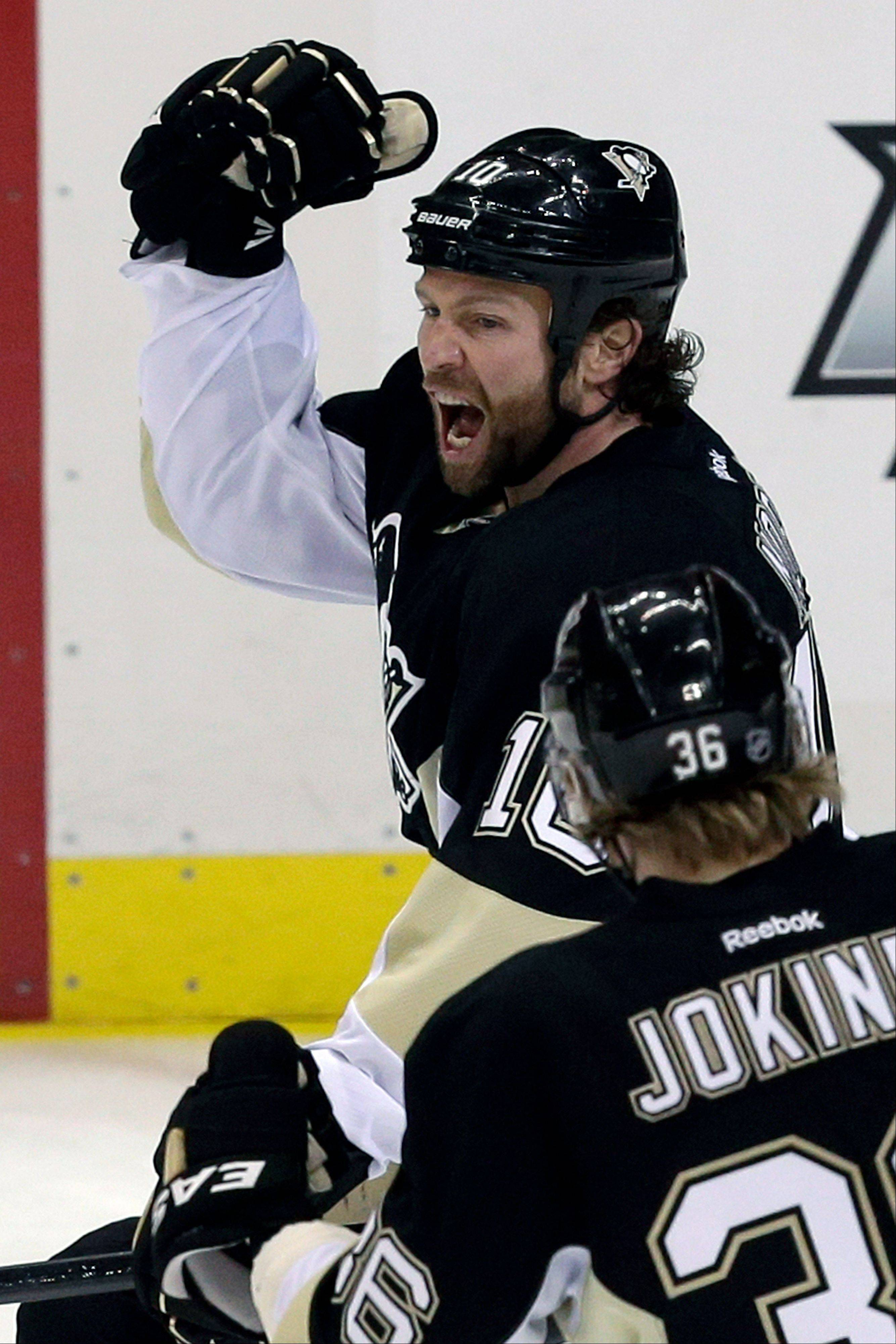Pittsburgh Penguins' Brenden Morrow (10) celebrates his first-period goal with teammate Jussi Jokinen (36) in Game 5 of the Eastern Conference semifinals in their NHL hockey Stanley Cup playoffs series, Friday, May 24, 2013, in Pittsburgh.