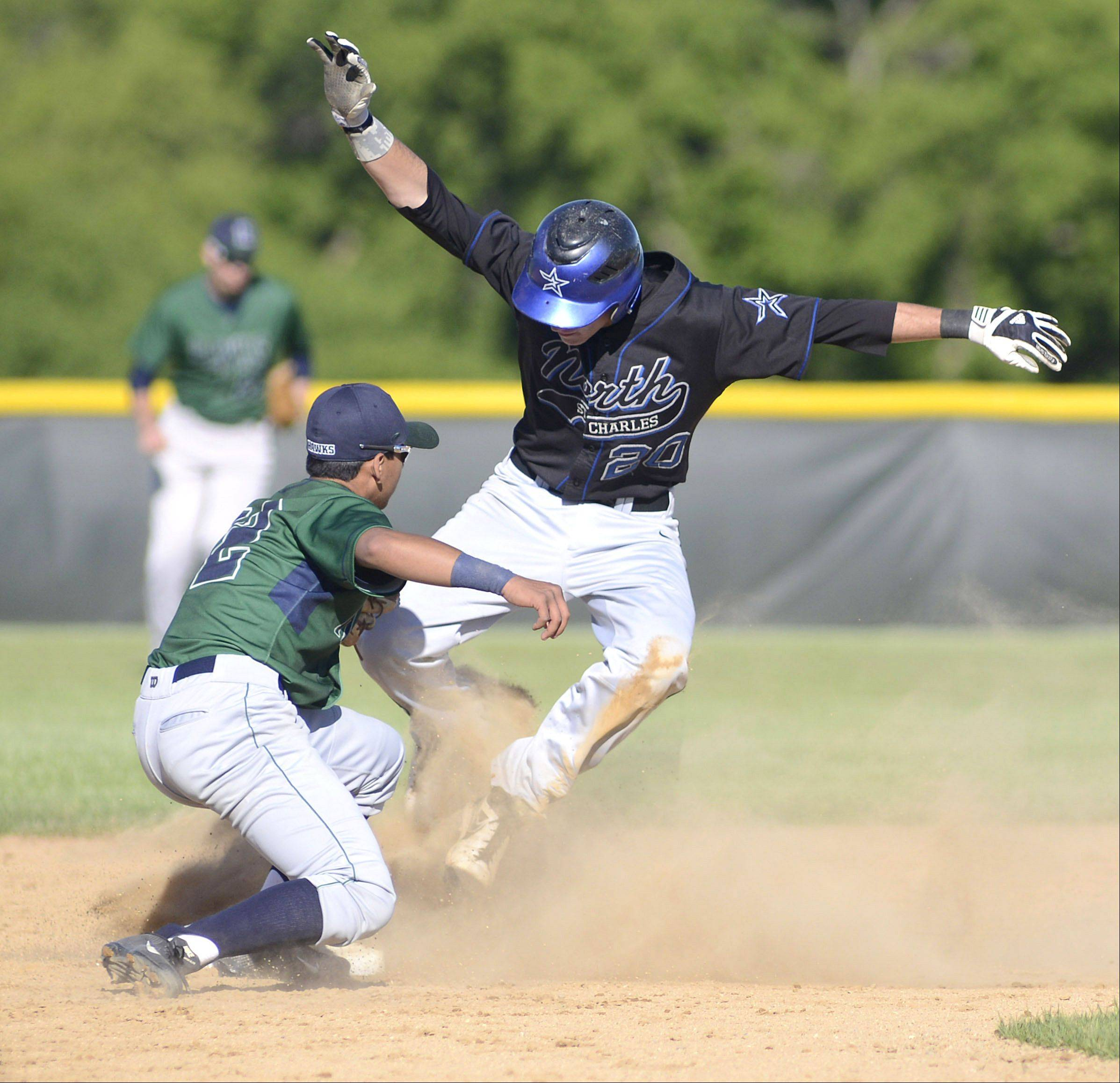 Bartlett's Sam Franco tags out St. Charles North's Cory Wright at second base in the fourth inning Friday.