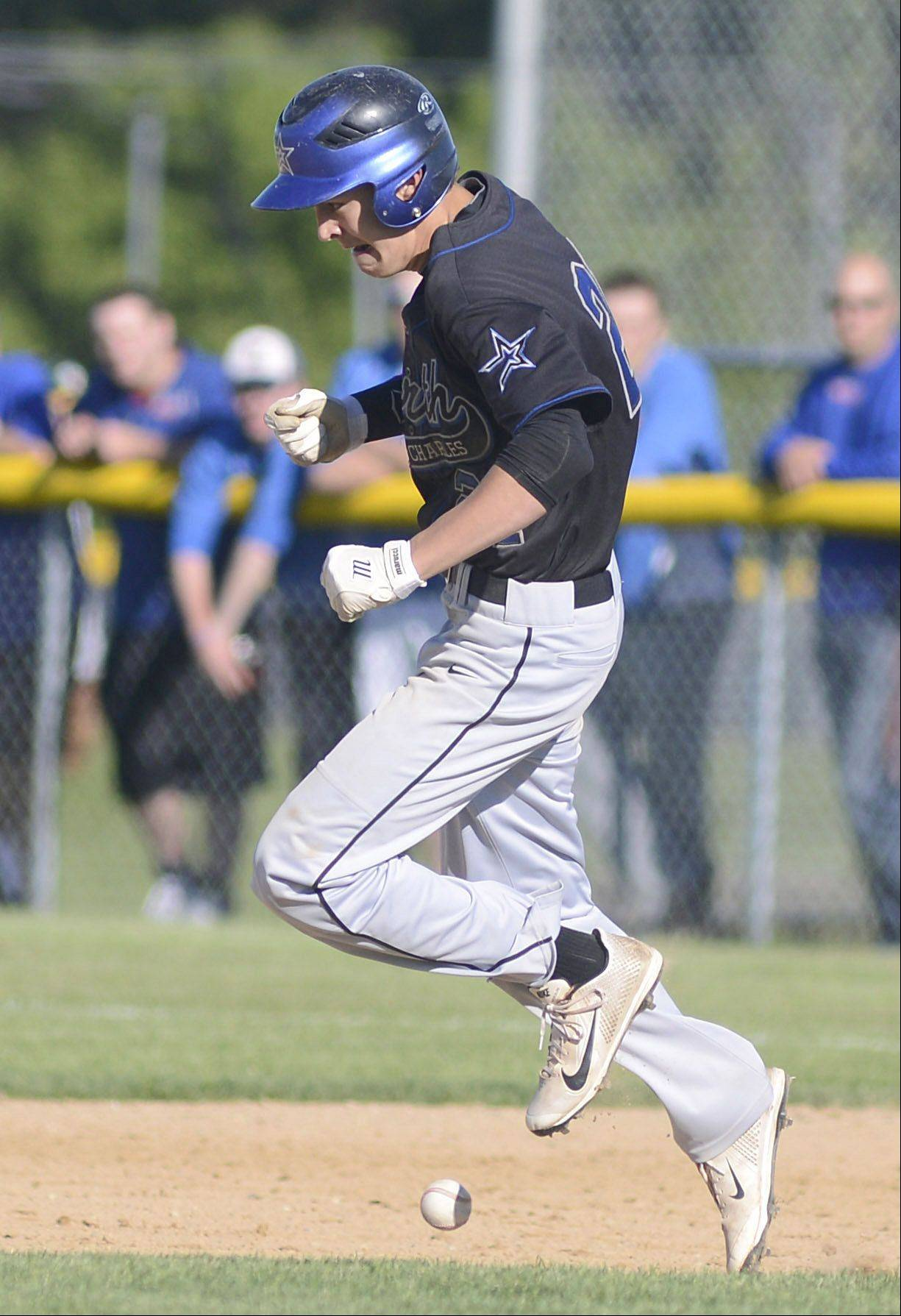 St. Charles North's John LeGare is called out as the ball knicks his shoe in the fourth inning Friday.