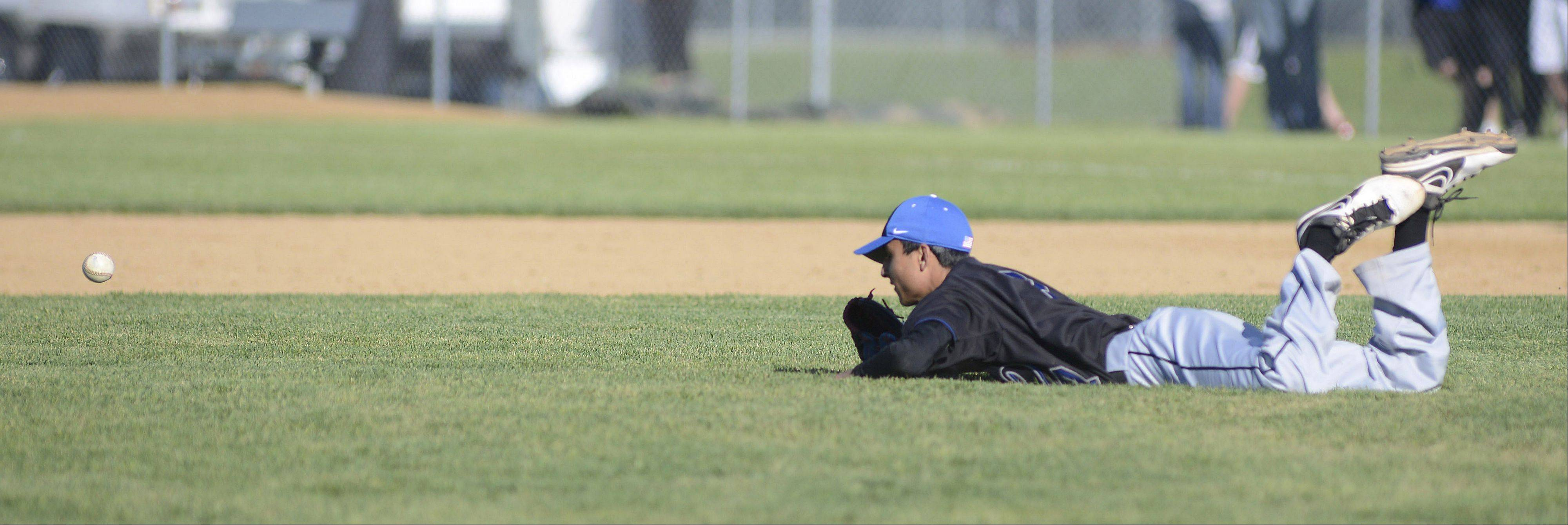 St. Charles North pitcher Ankur Shah dives short of the ball Friday.