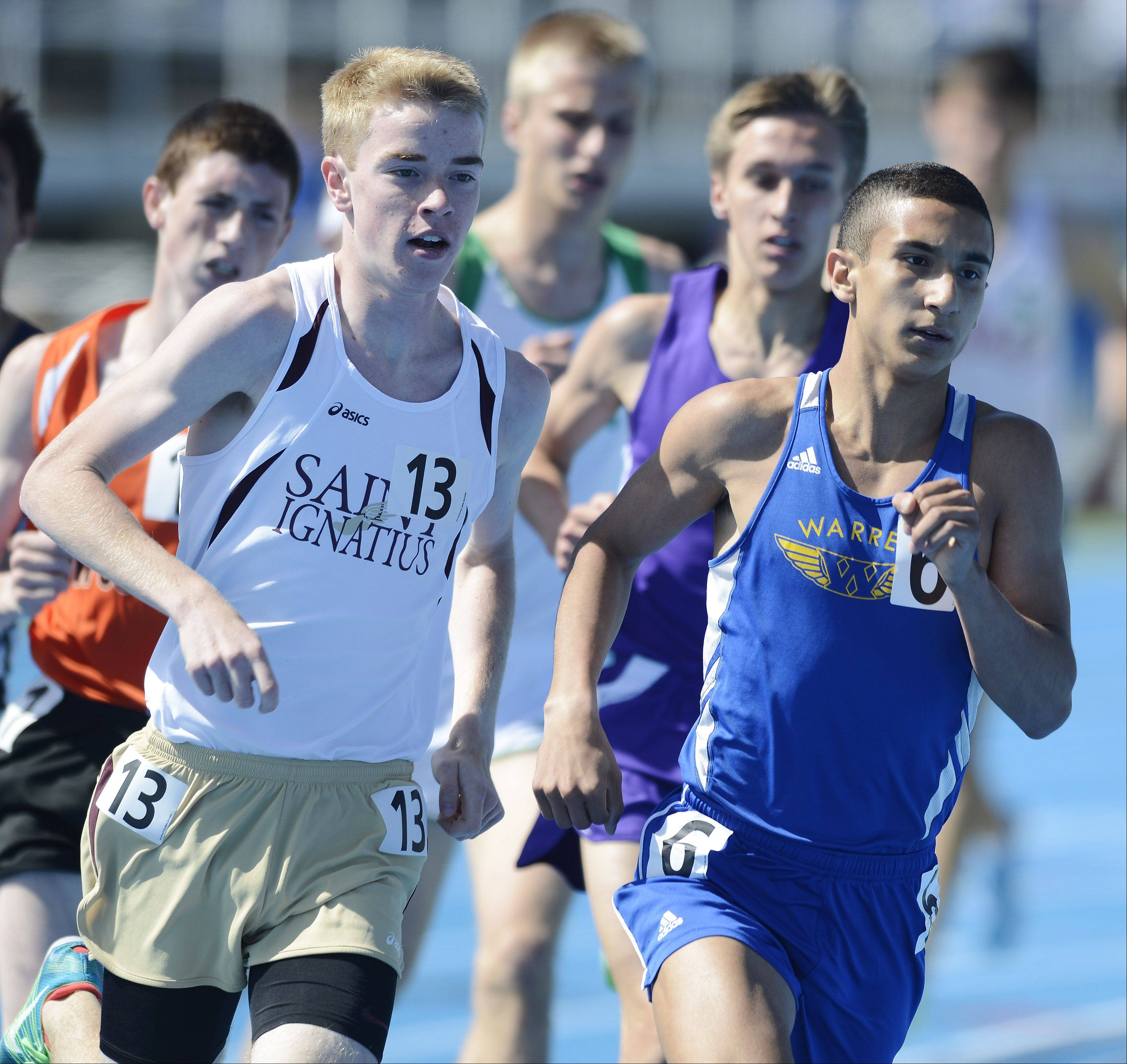 Warren's Martin Martinez competes in the Class 3A 1,600-meter run during the boys track state meet preliminaries in Charleston on Friday.