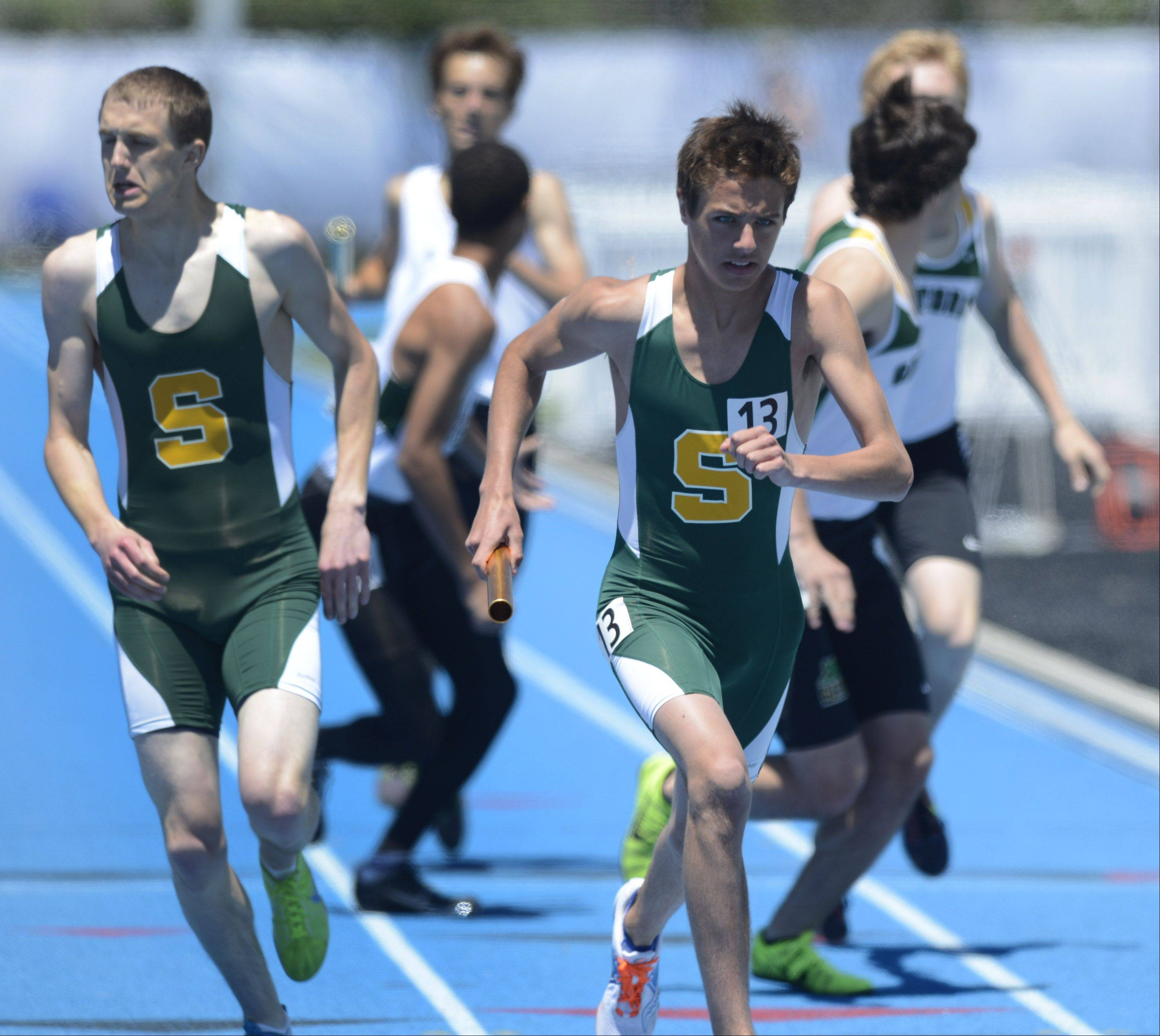 Stevenson's Jared Borowsky carries the baton for his team in the Class 3A 4x800-meter relay during the boys track state meet preliminaries in Charleston on Friday.