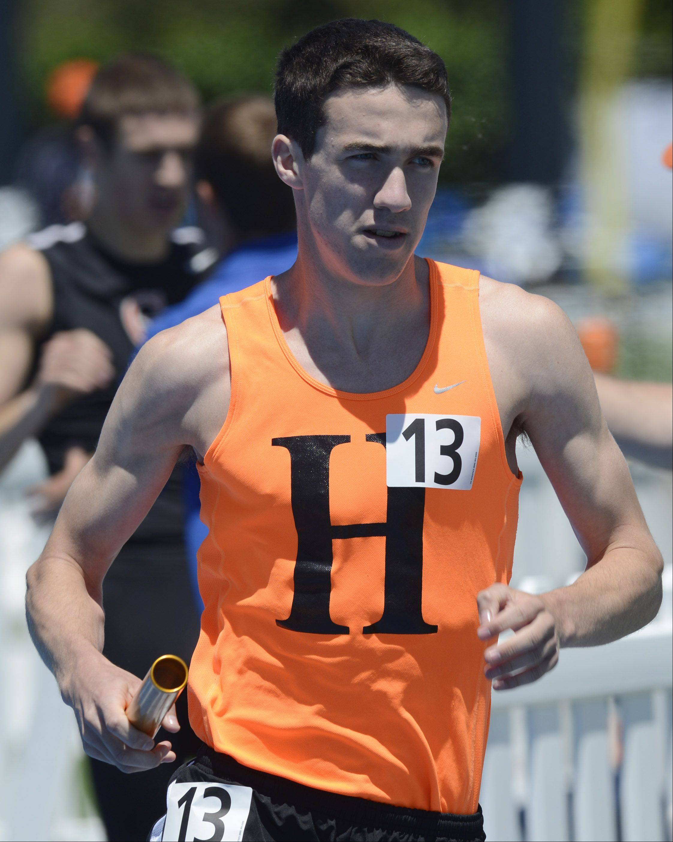 Hersey's Robert Somary runs in the Class 3A 4x800-meter relay during the boys state track preliminaries in Charleston Friday.