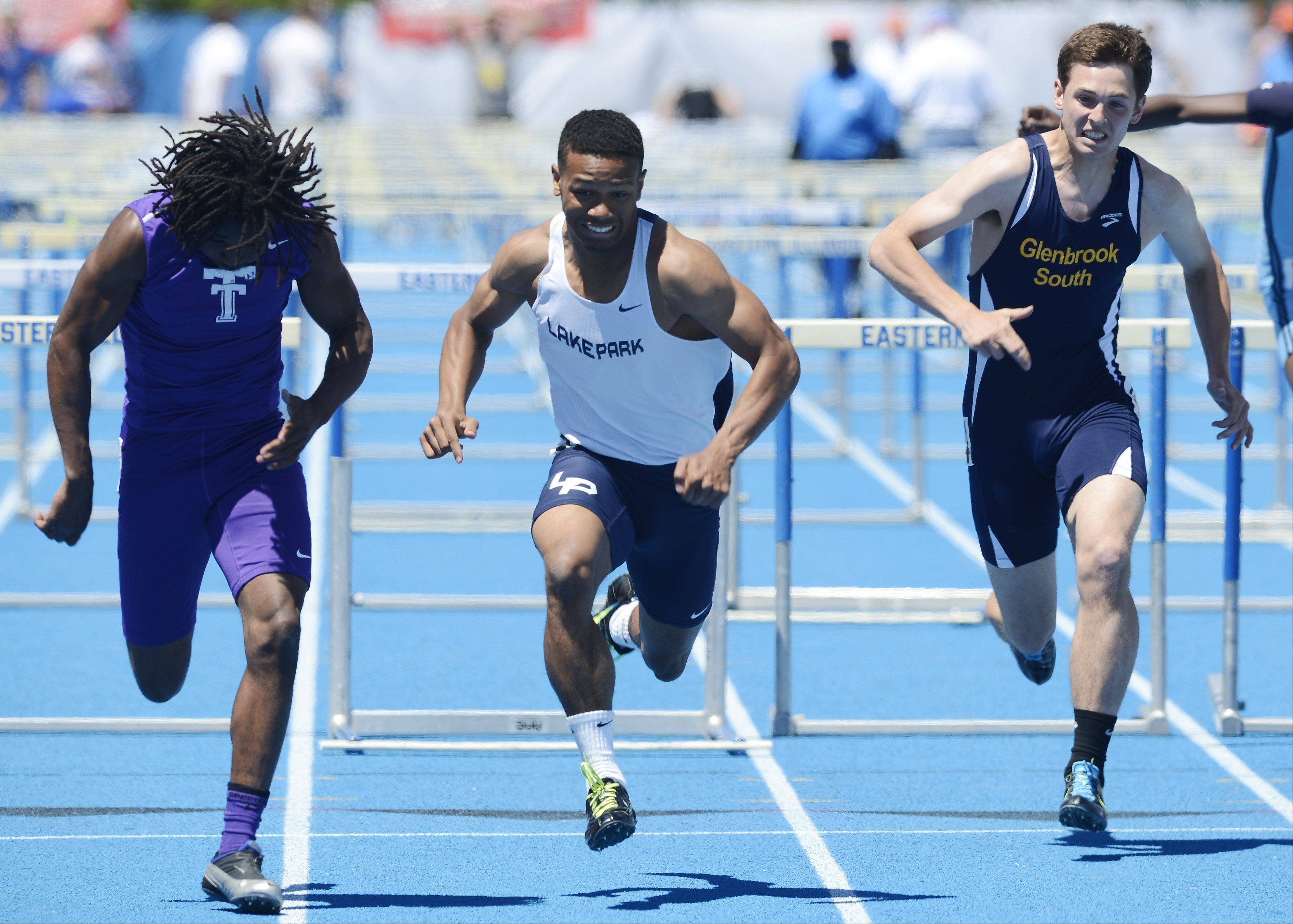 Antonio Shenault of Lake Park, middle, heads for the finish line in the Class 3A 110-meter high hurdles during the boys state track preliminaries in Charleston Friday.