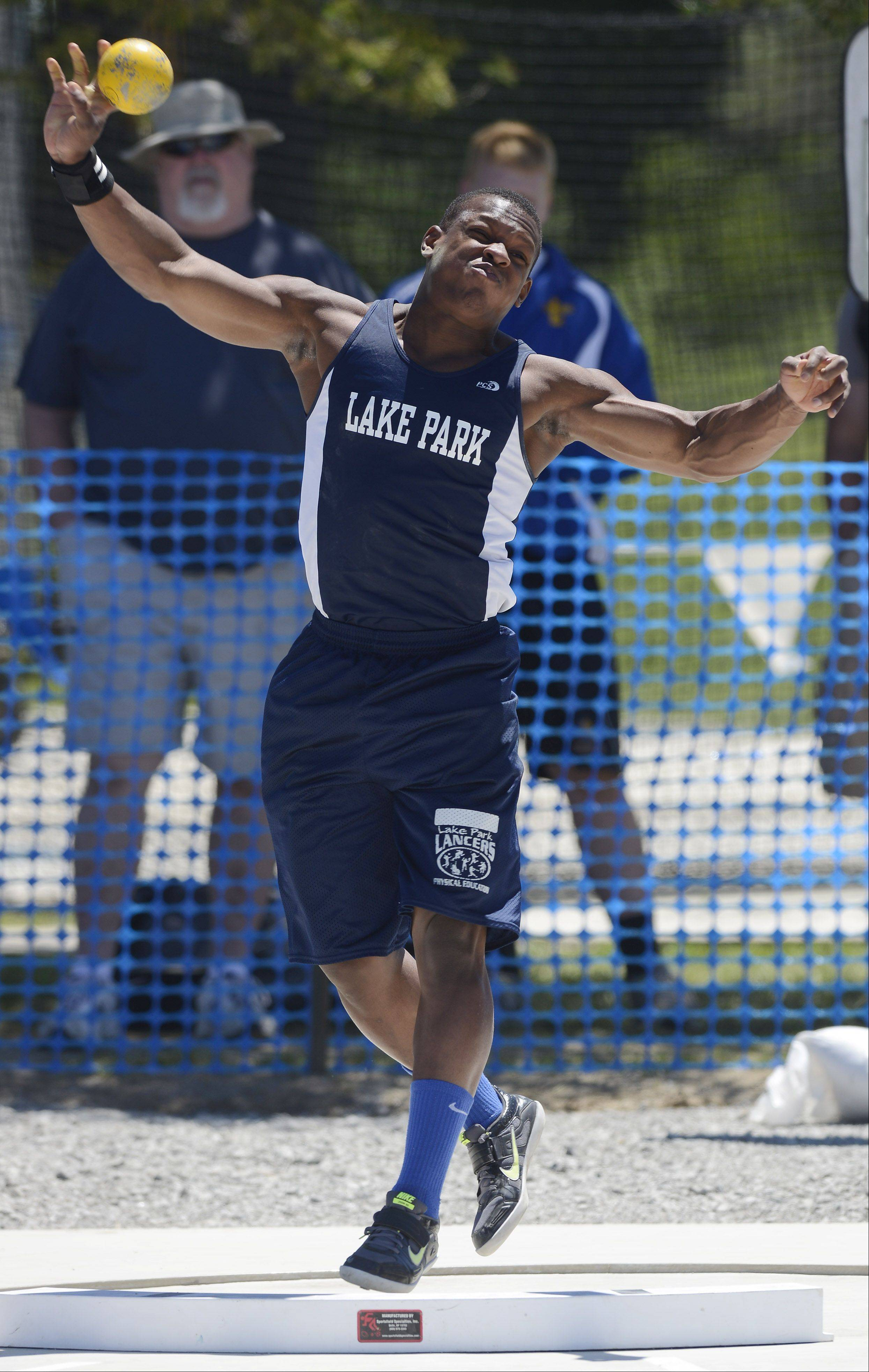 Lake Park's Curtwan Evans throws in the Class 3A shot put during the boys state track preliminaries in Charleston Friday.