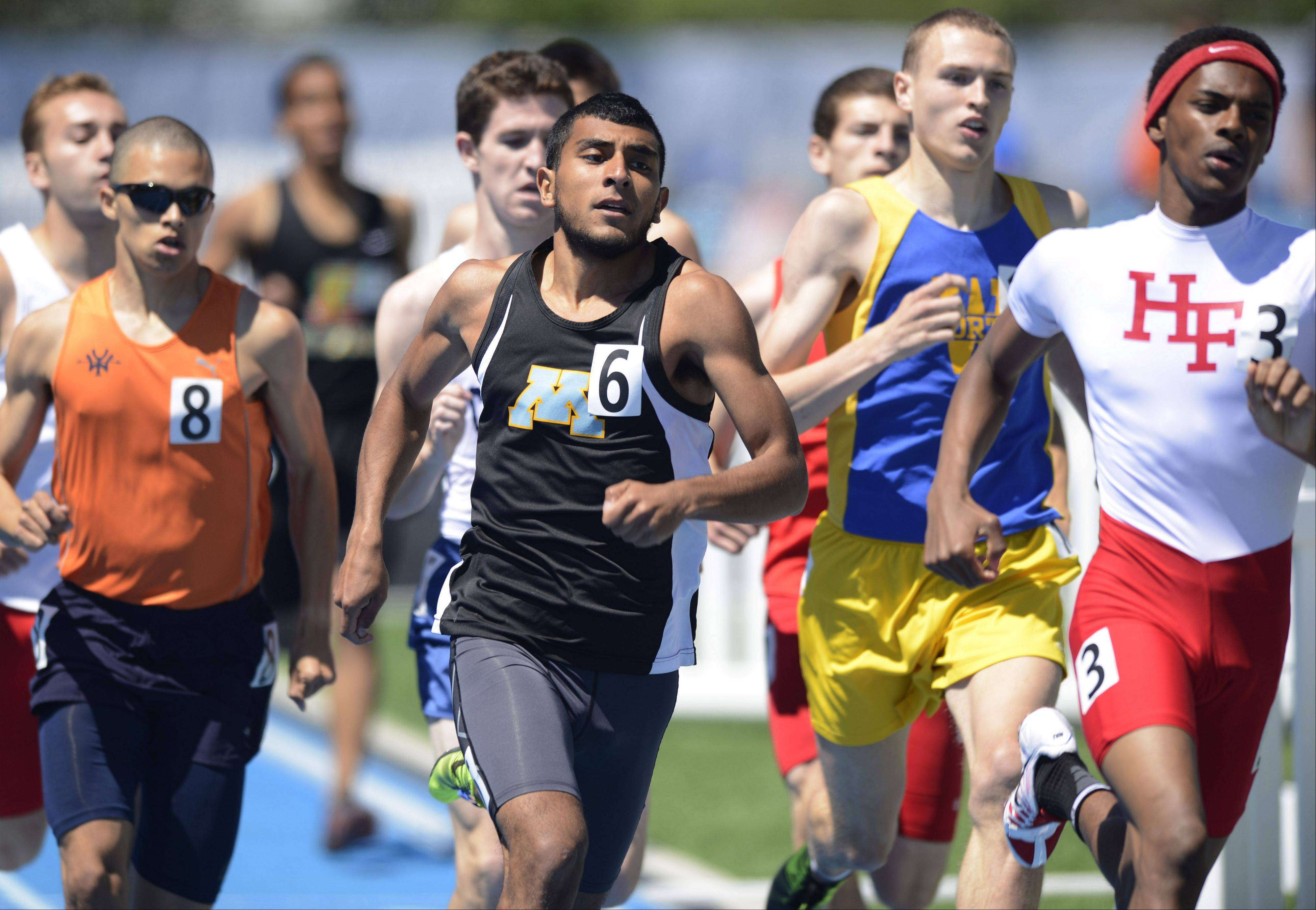Maine West's Alex Gasca, middle, competes in the Class 3A 800-meter run during the boys state track preliminaries in Charleston Friday.