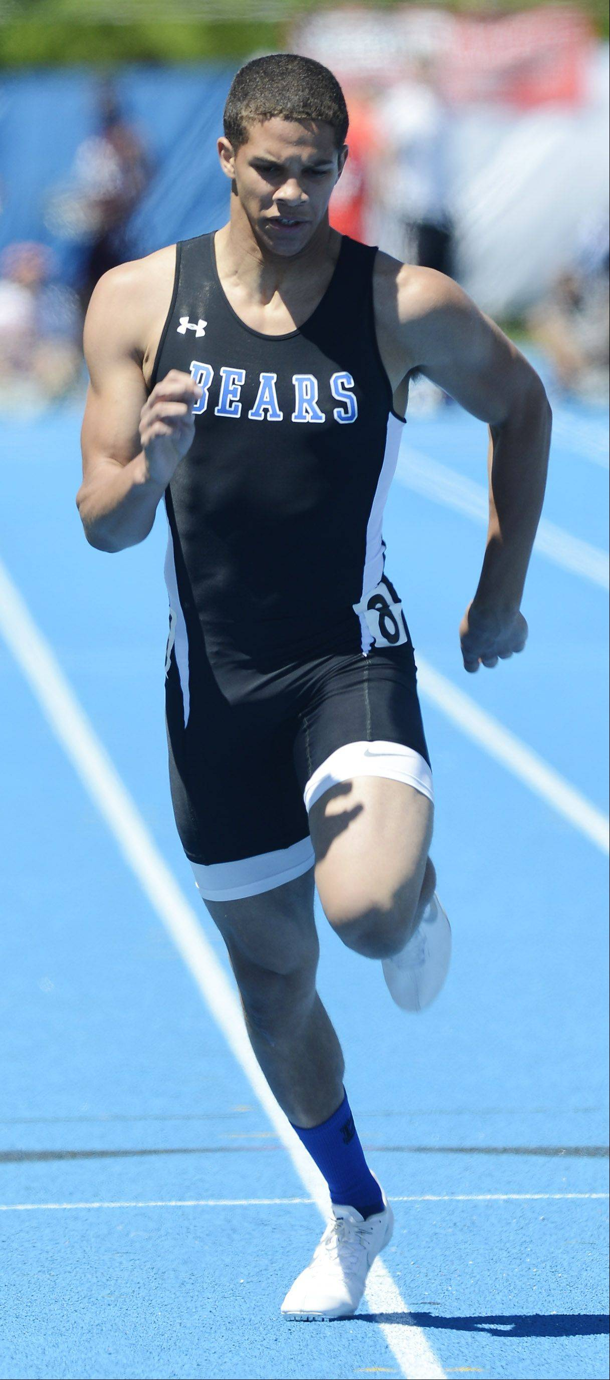 Lake Zurich's Ben Klett heads for the finish line in the Class 3A 100-meter dash during the boys state track preliminaries in Charleston Friday.