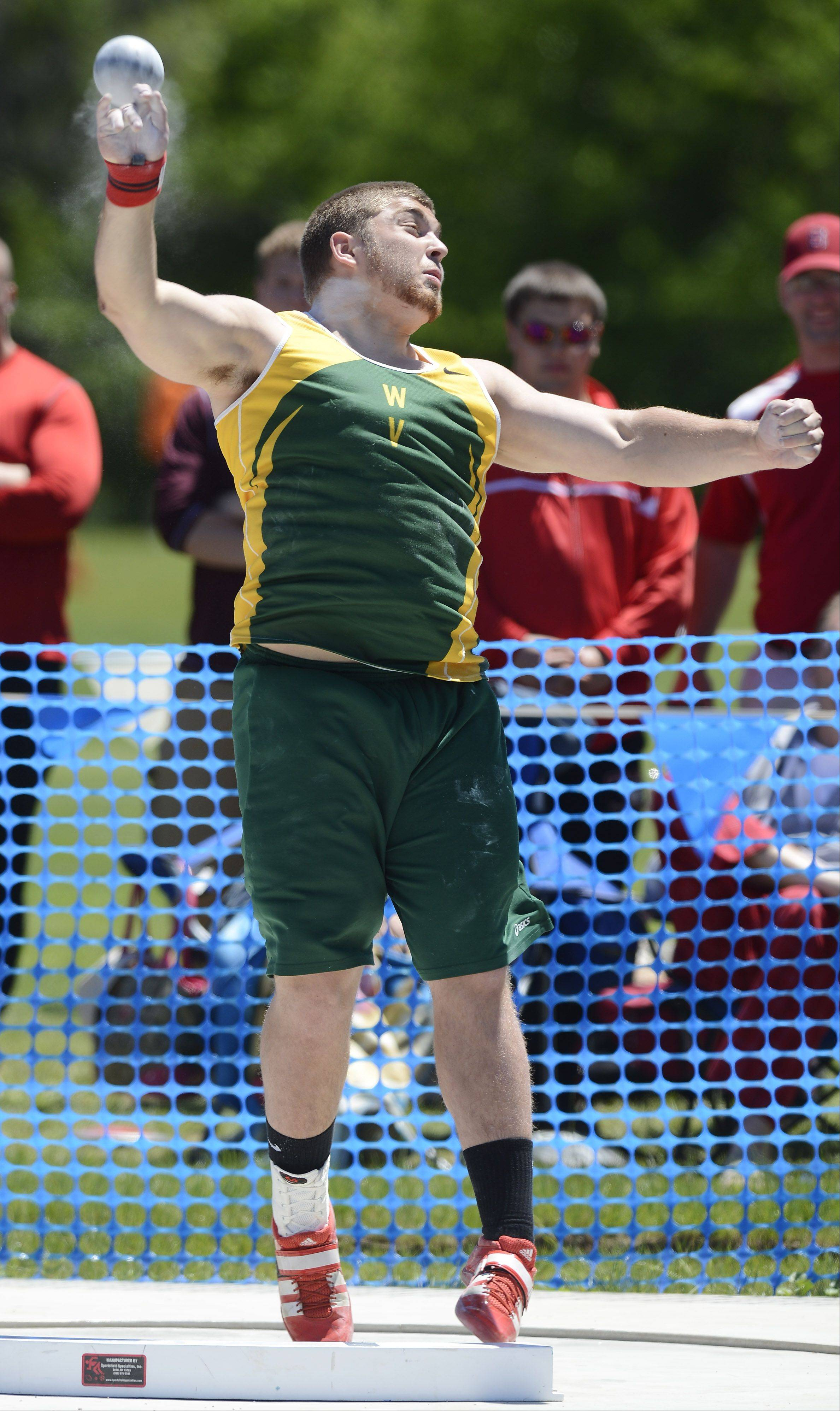 Riley Kittridge of Waubonsie Valley throws in the Class 3A shot put during the boys state track preliminaries in Charleston Friday.