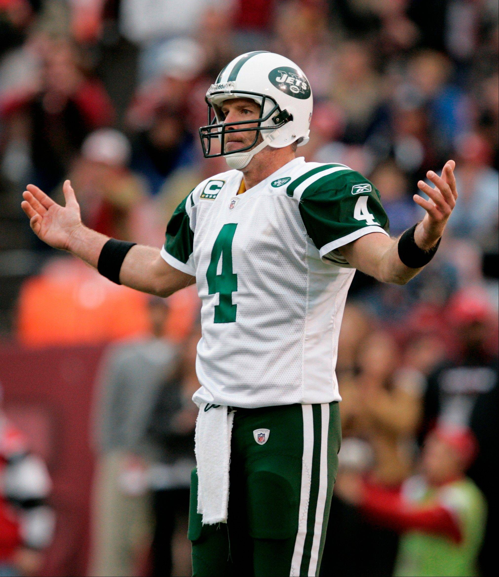 FILE - In this Dec. 7, 2008, file photo, New York Jets quarterback Brett Favre reacts to a missed pass during the second half on an NFL football game against the San Fransisco 49ers in San Francisco. A lawsuit filed by two massage therapists who sued retired NFL quarterback Brett Favre over claims he sent racy text messages has been settled, a lawyer for the women said Friday, May 24, 2013.