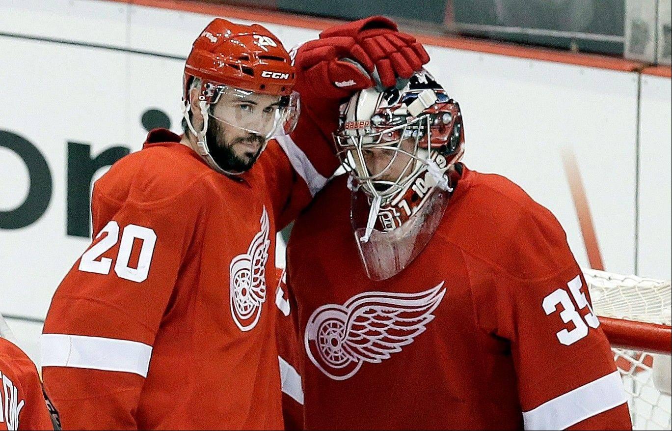 Detroit Red Wings goalie Jimmy Howard, right, has plenty of confidence after three straight victories over the Blackhawks. The Hawks need a Game 5 win to avoid elimination.