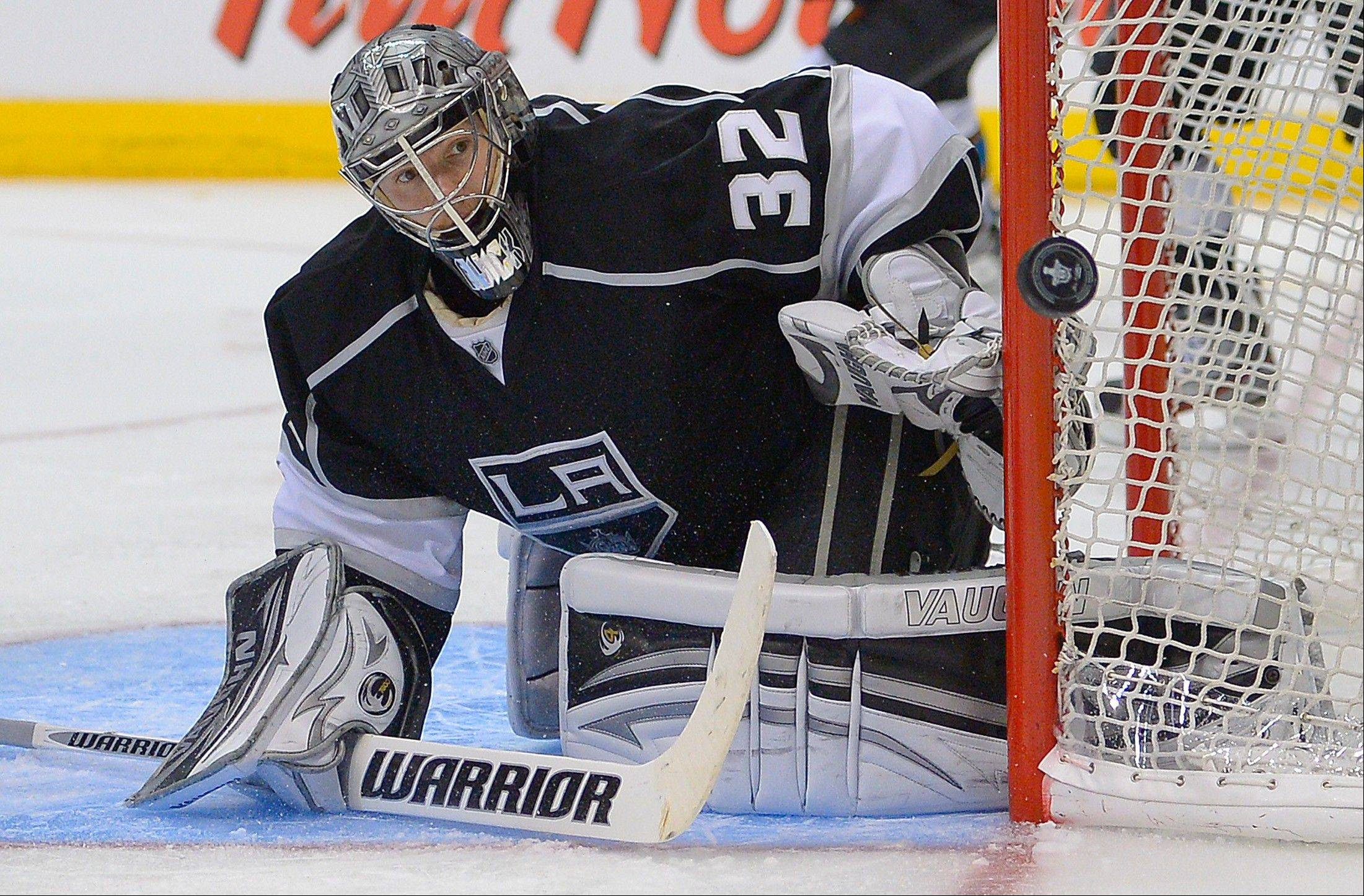 Los Angeles Kings goalie Jonathan Quick (32) deflects a shot during the third period against the San Jose Sharks in Game 5 of the Western Conference semifinals in the NHL hockey Stanley Cup playoffs, Thursday, May 23, 2013, in Los Angeles.