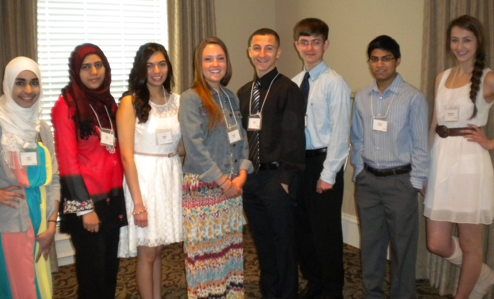 Eight of 20 scholarship winners for 2013 attend the May meeting of WCI. Pictured, from left, are Sana Shafiuddin, Sana Quadri, Joana Quillo, Emily Manley, Flavio Kola, Michael Anderson, Nabeel Qureshi and Andriana Krivonosov.