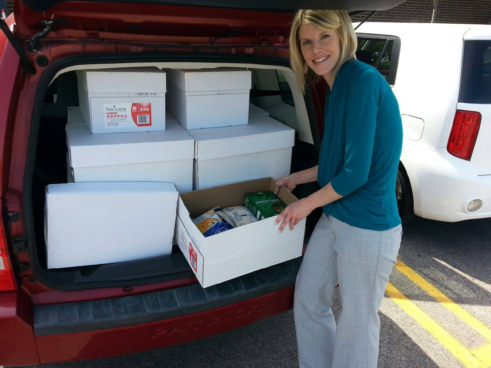 Julie Scholma, of Roselle Middle School, delivering the donated food to Humanitarian Service Project.