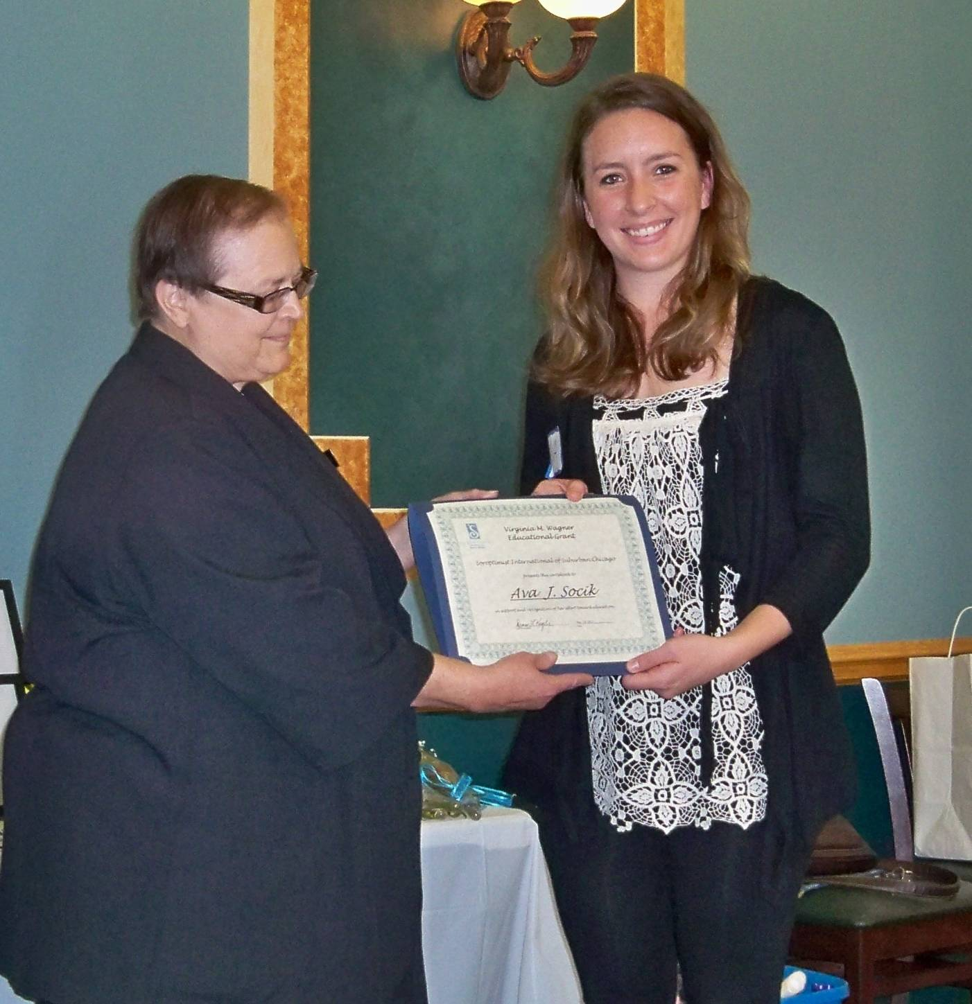 Ava Socik of Niles receives the Virginia M. Wagner Educational Grant from local Club President, Diane Kegley