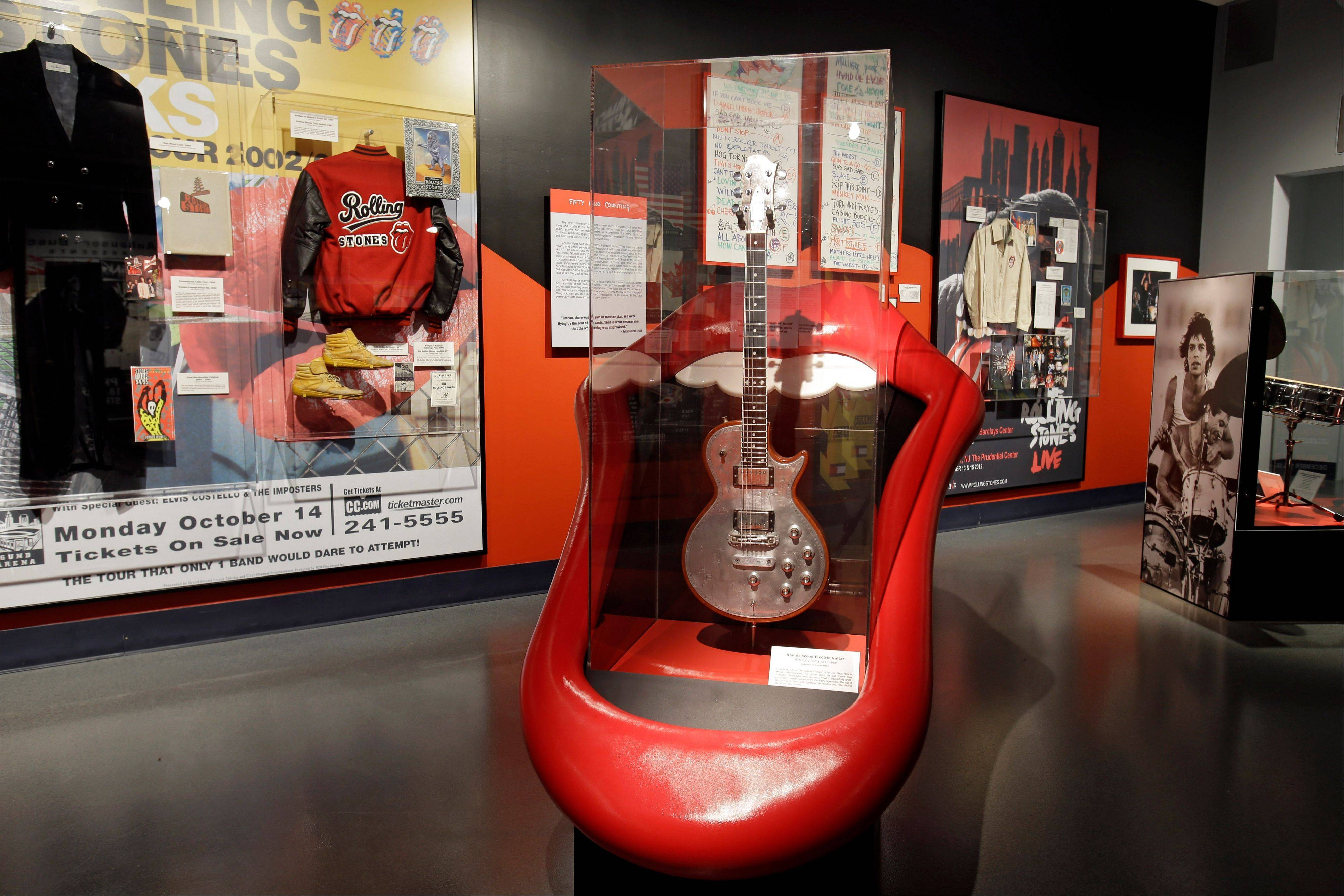 "Rolling Stones memorabilia is displayed at the Rock and Roll Hall of Fame in Cleveland in the new exhibit ""Rolling Stones 50 Years of Satisfaction."""