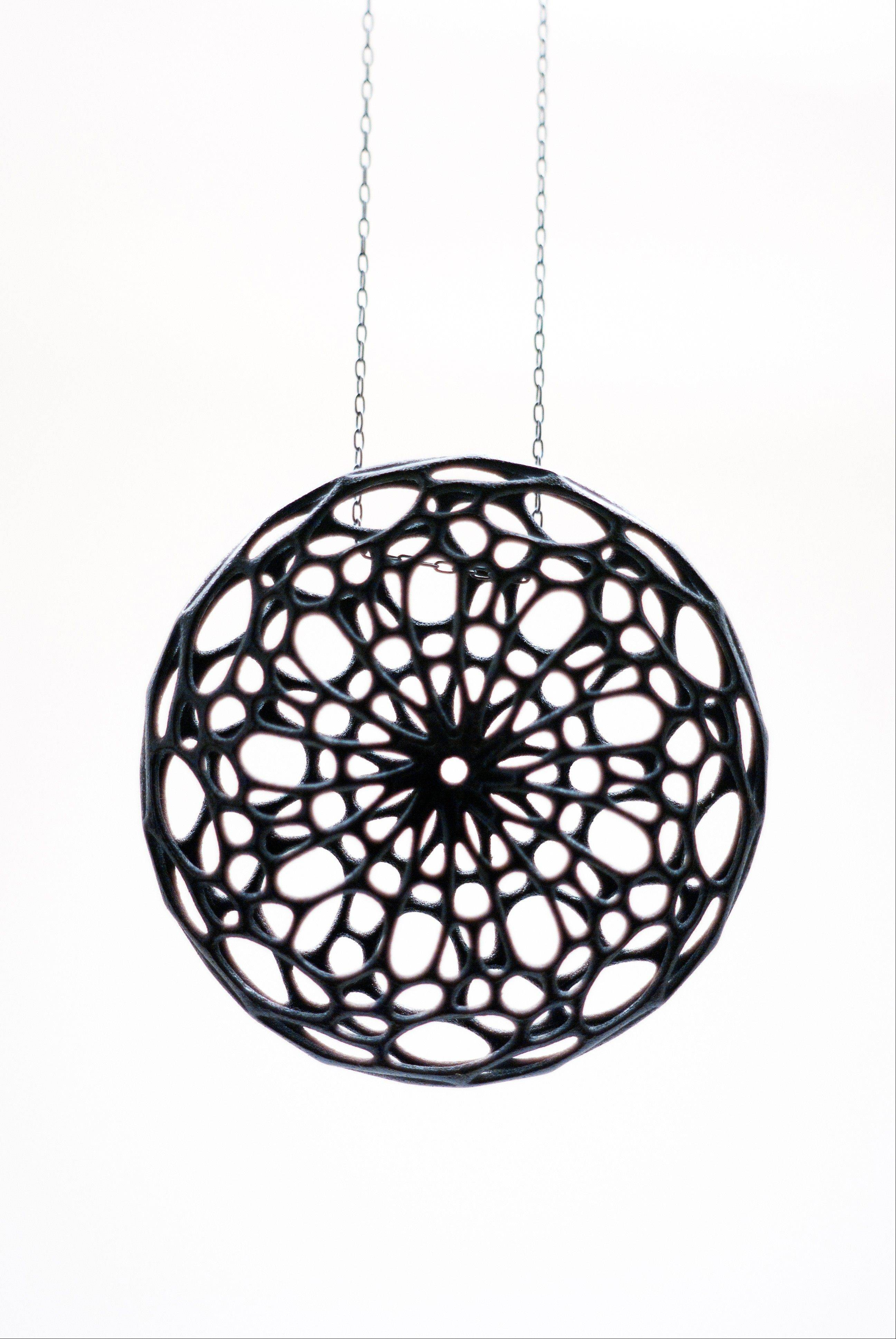 A black nylon plastic Cellular Pendant, created by designer Jessica Rosenkrantz. This and other pieces were inspired by cell-like structures found in nature.