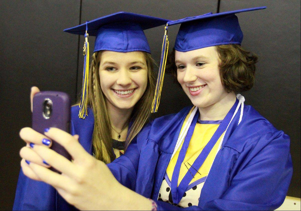 Caitlin Purdome takes a photo of Amy Foster and herself before Warren Township High School�s commencement ceremony.
