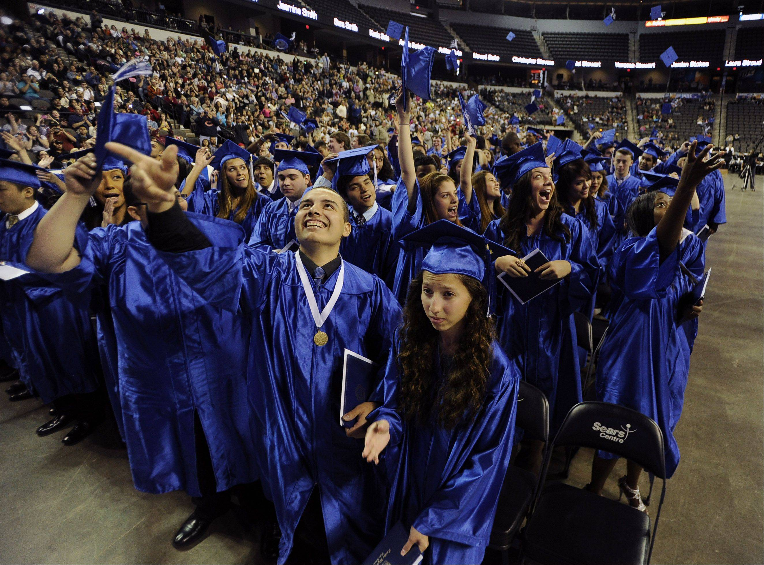 The class of 2013 Larkin High School graduates celebrate by the famous cap toss at the end of the commencement at the Sears Centre in Hoffman Estates on Saturday.