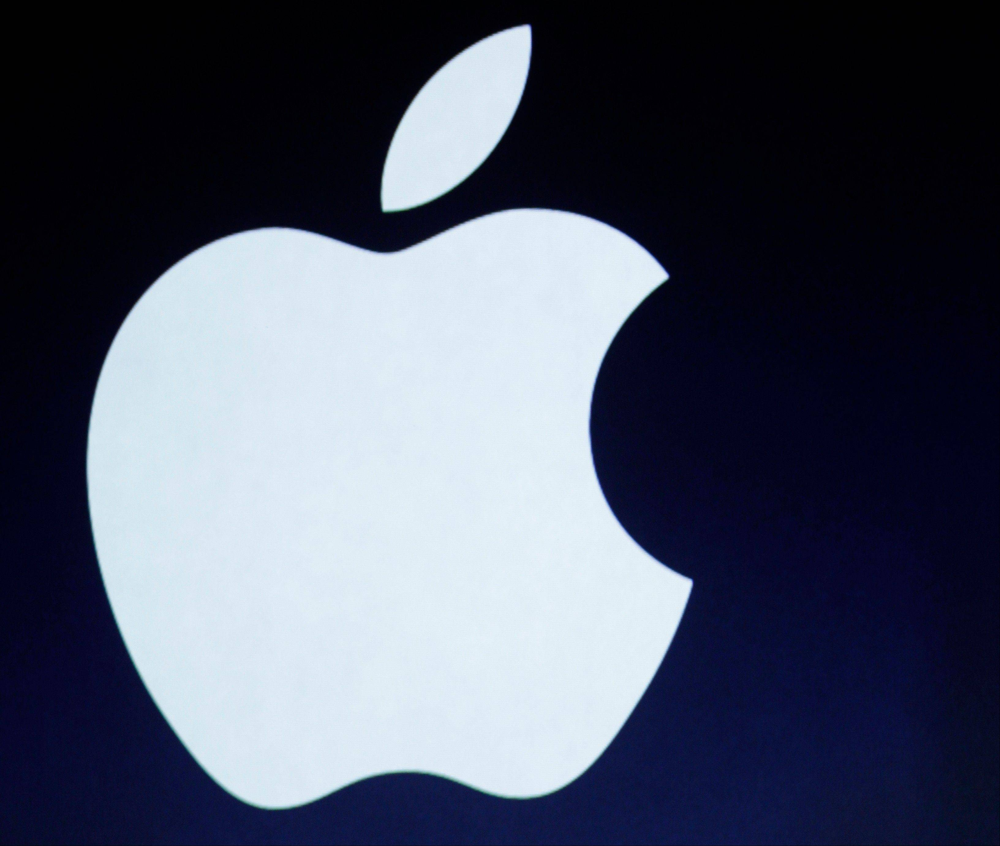 Associated Press/March 7, 2012 The Apple logo is projected during an announcement in San Francisco.