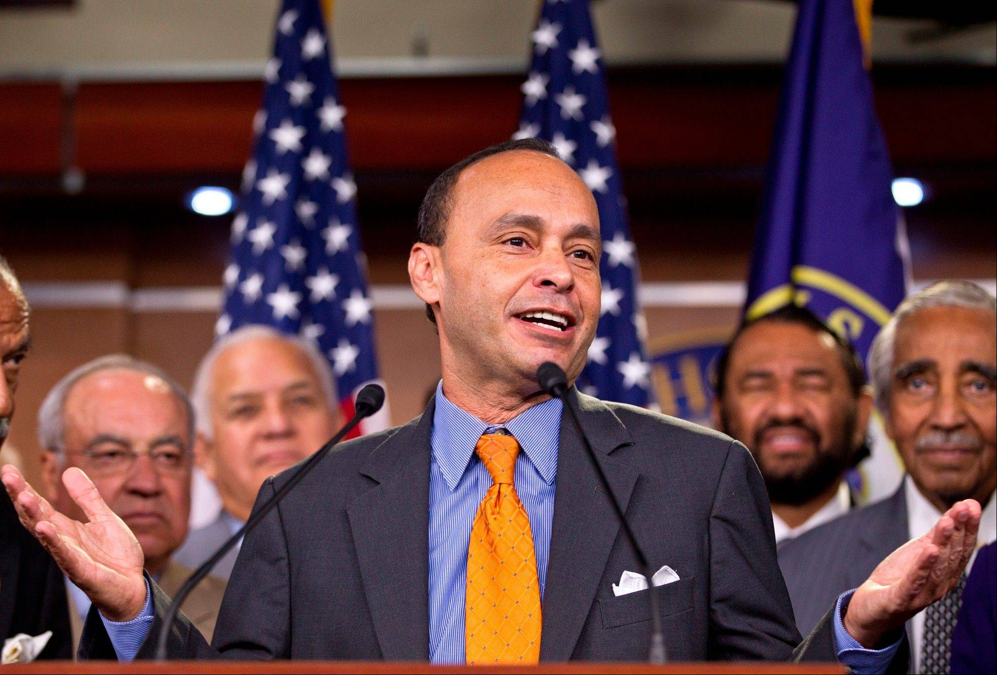 Rep. Luis Gutierrez, a Democrat from Illinois, center, accompanied by fellow House members in August last year, speaks during a news conference on Capitol Hill in Washington. House members writing a bipartisan immigration bill said Thursday they had patched over a dispute that threatened their efforts, even as they and the rest of Congress prepared to return home for a weeklong recess where many could confront voter questions on the issue. �I�m very pleased,� Gutierrez said. �We�re going to get there. There�s going to be justice done for our immigrant community.�