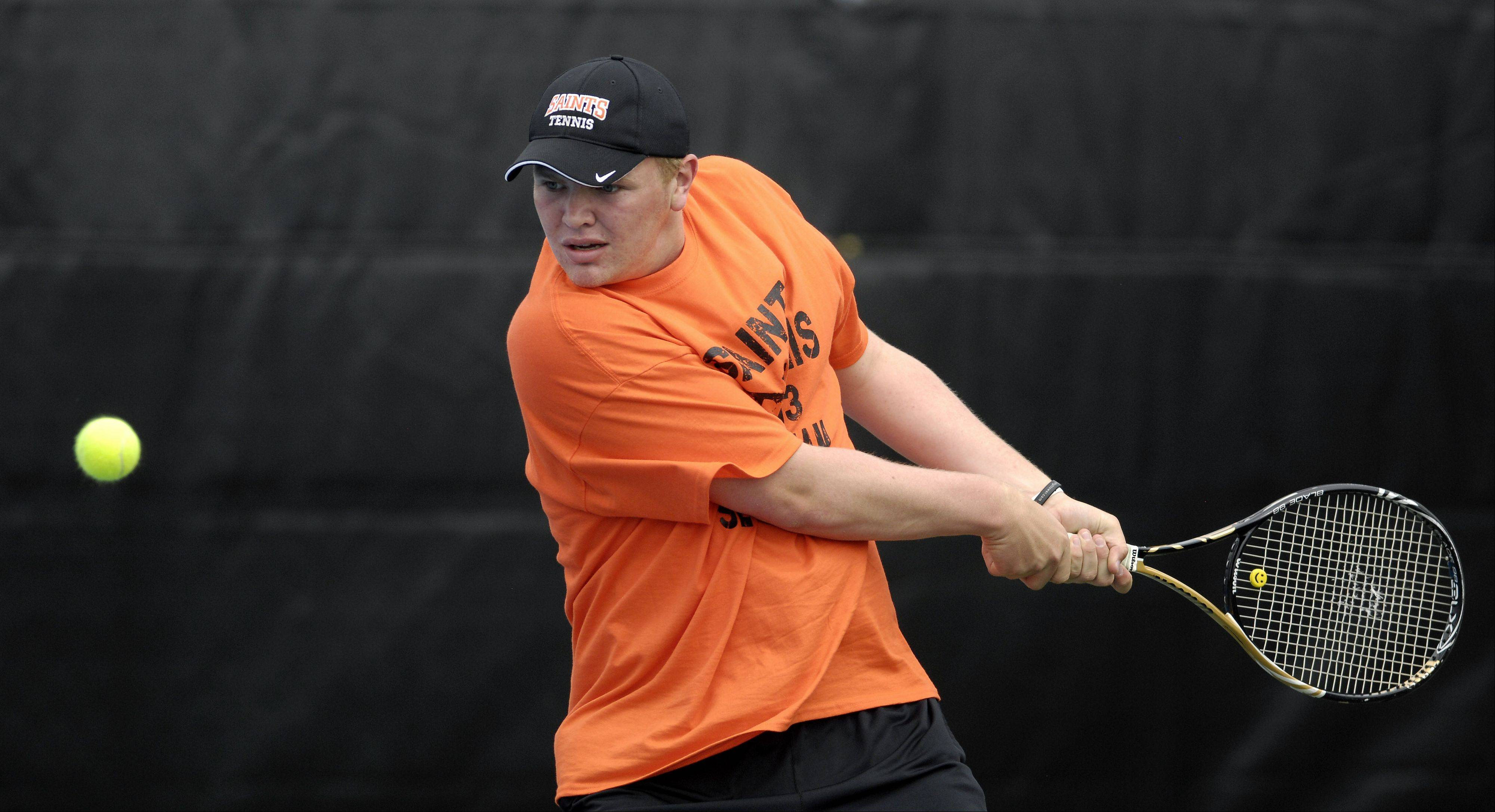 Rick West/rwest@dailyherald.com St. Charles East's Jasper Koenen readies his backhand during sectional tennis action at St. Charles North High School Friday.