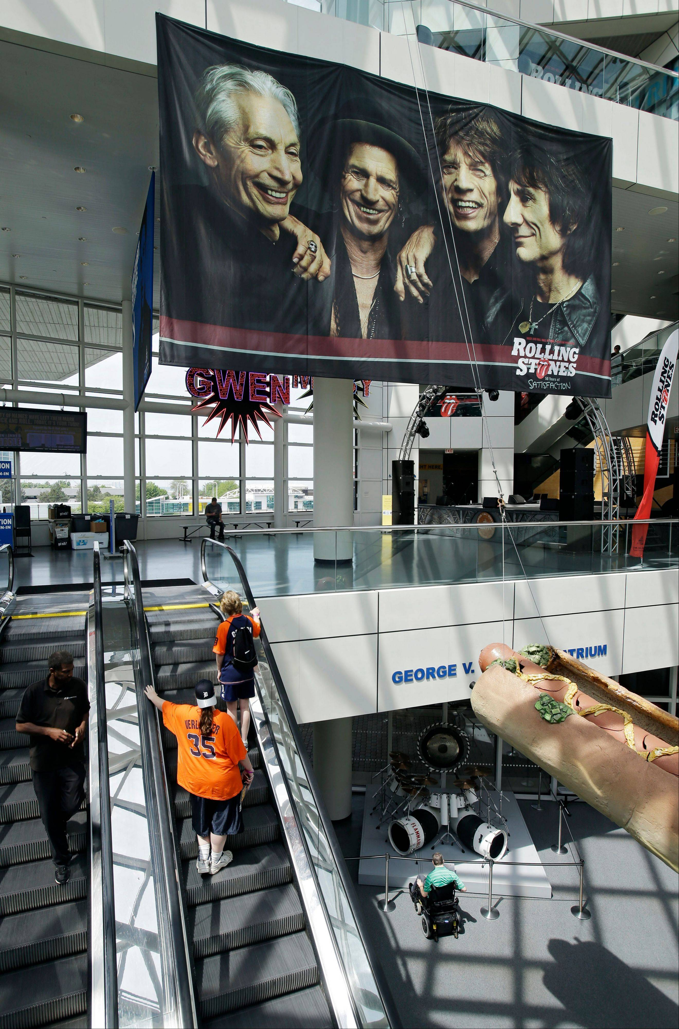 "A large banner for a new exhibit, ""Rolling Stones 50 Years of Satisfaction,"" greets visitors in the main atrium at the Rock and Roll Hall of Fame in Cleveland."