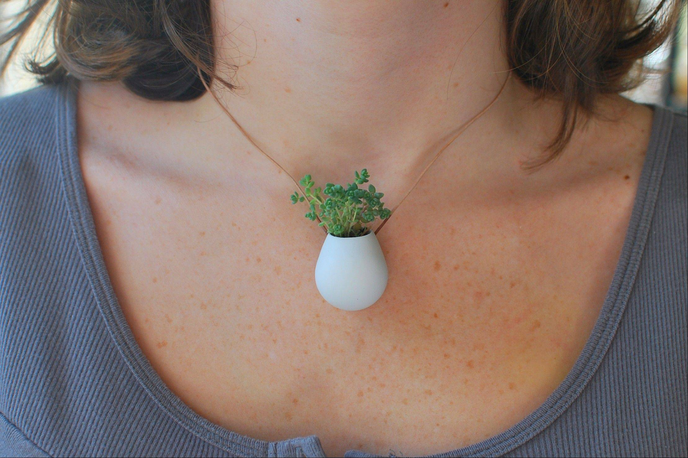 Colleen Jordan, of Atlanta, shows off a tiny wearable planter she created using 3-D modeling software.