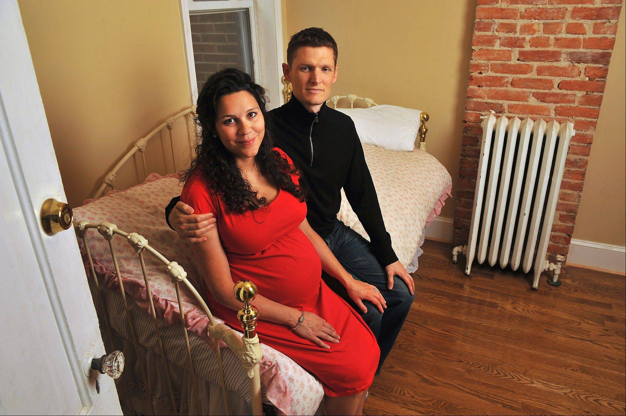Luke Armerding and his wife, Juliet, in one of the bedrooms they renovated in their townhouse. Friends helped with part of the work.
