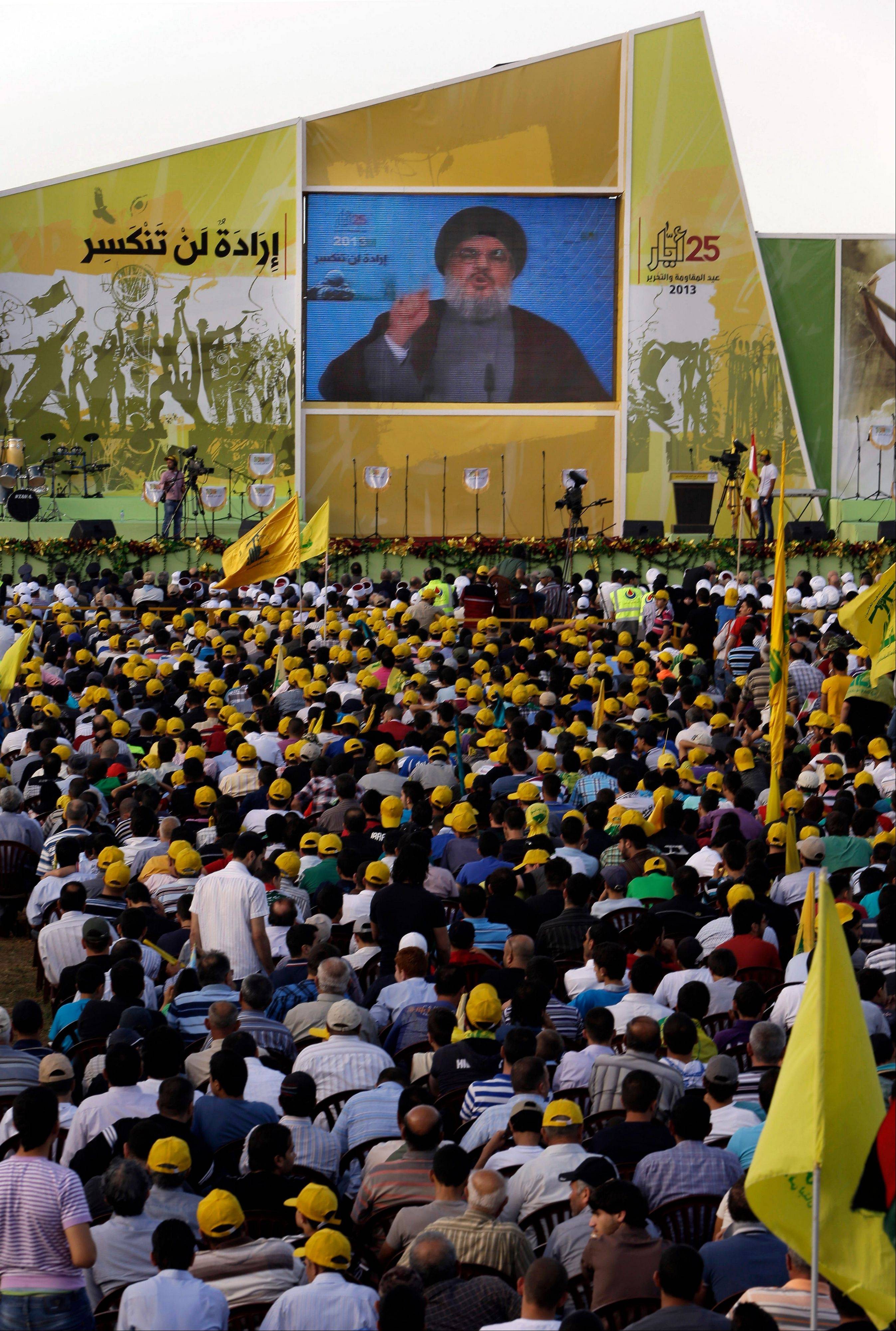 "Hezbollah leader Sheik Hassan Nasrallah speaks Saturday from an undisclosed location during a rally commemorating ""Liberation Day,"" which marks the withdrawal of the Israeli army from southern Lebanon in 2000, in Mashghara village, Bekaa valley, Lebanon."