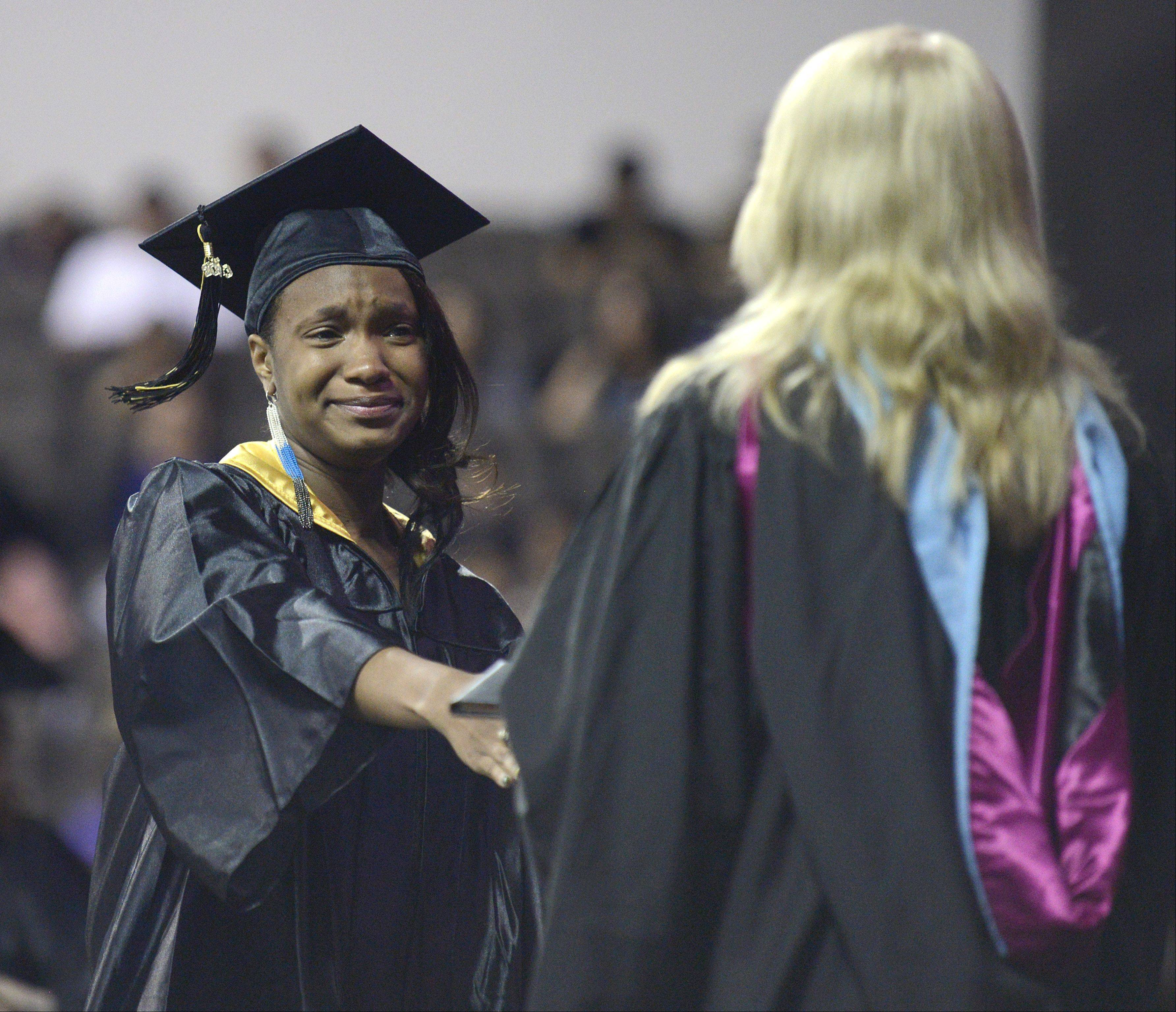 Kanika Bowens is brought to tears as she receives her diploma at Streamwood High School's commencement ceremony at the Sears Centre in Hoffman Estates on Saturday, May 25.