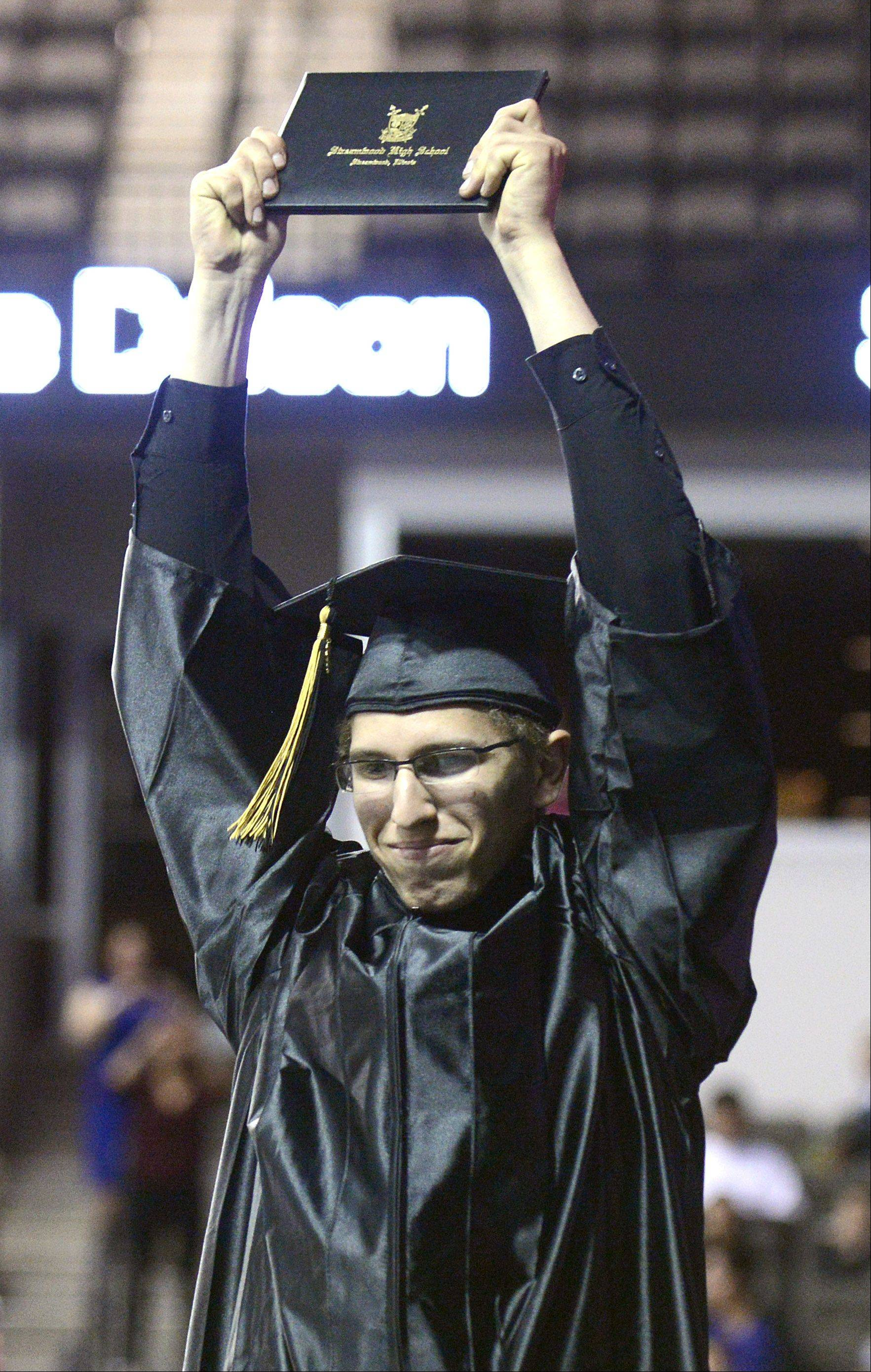 Harlen Christensen shows off his diploma at Streamwood High School's commencement ceremony at the Sears Centre in Hoffman Estates on Saturday, May 25.