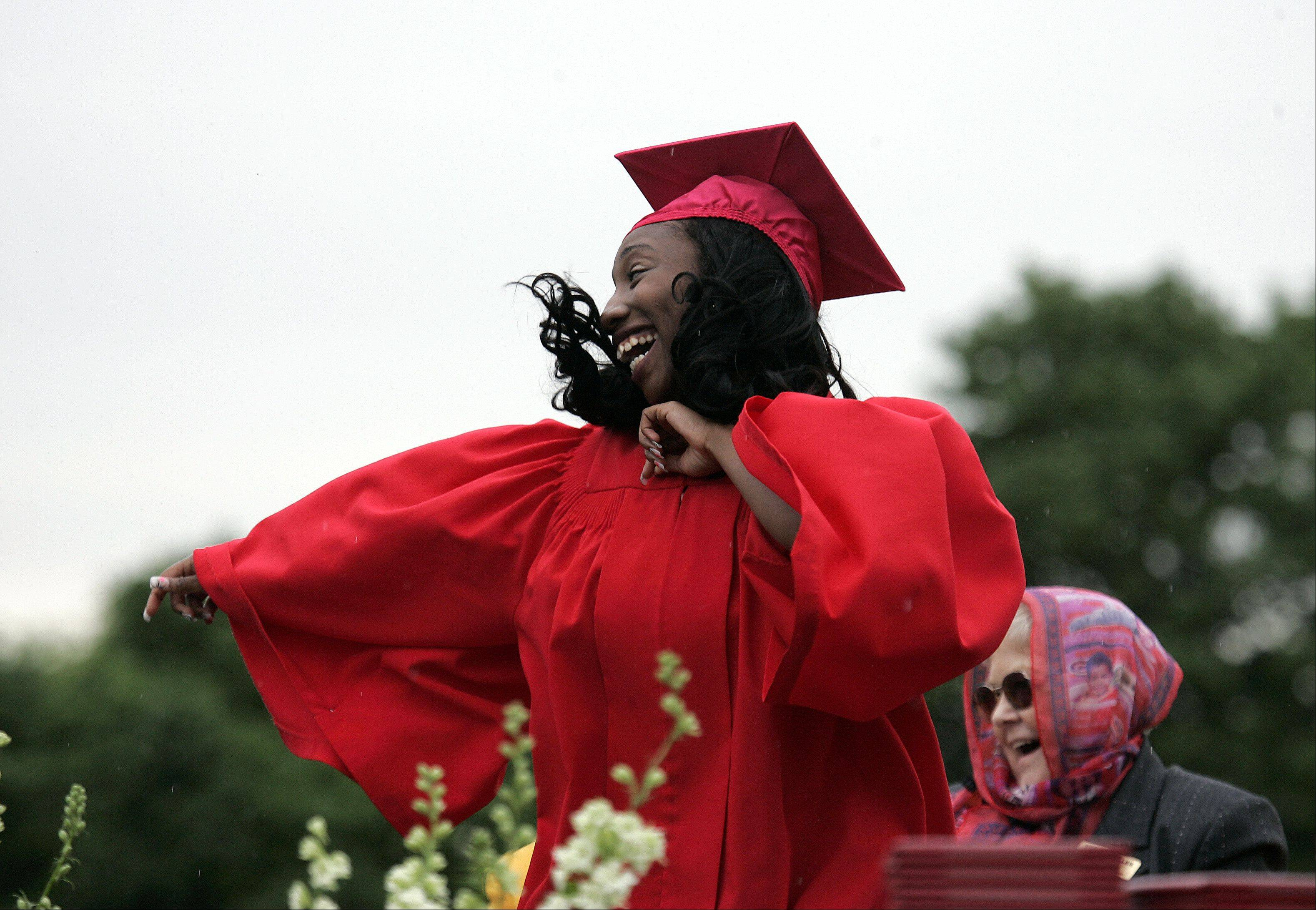 U-Conjay Nelson lets out her excitement with a little dance as her name is called for her diploma during the 95th Annual Commencement ceremony of Mooseheart High School in Batavia Saturday.