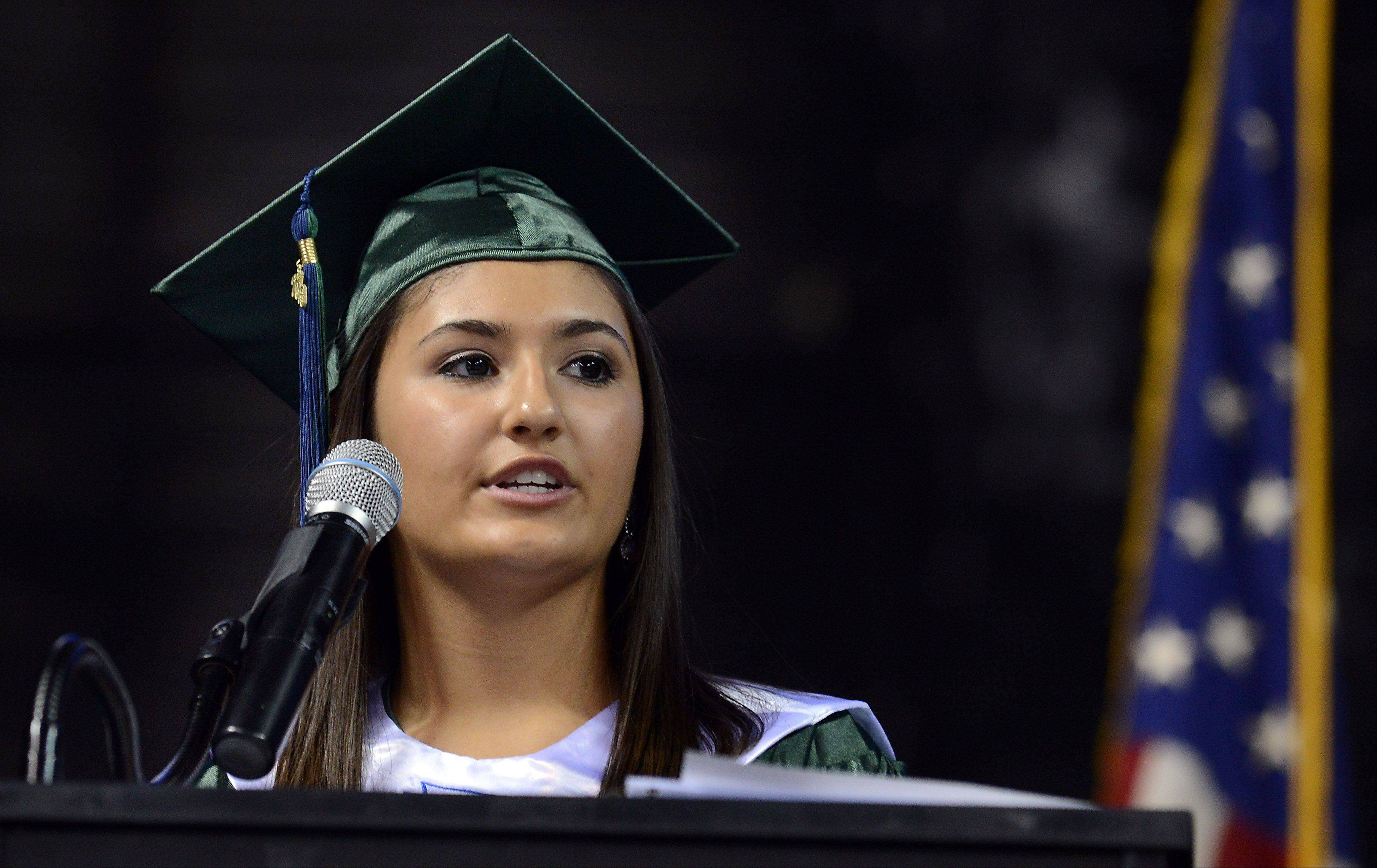 Daniella Amato, senior class president speaks to her classmates as she takes part in the Bartlett High School Commencement at the Sears Centre in Hoffman Estates on Saturday.