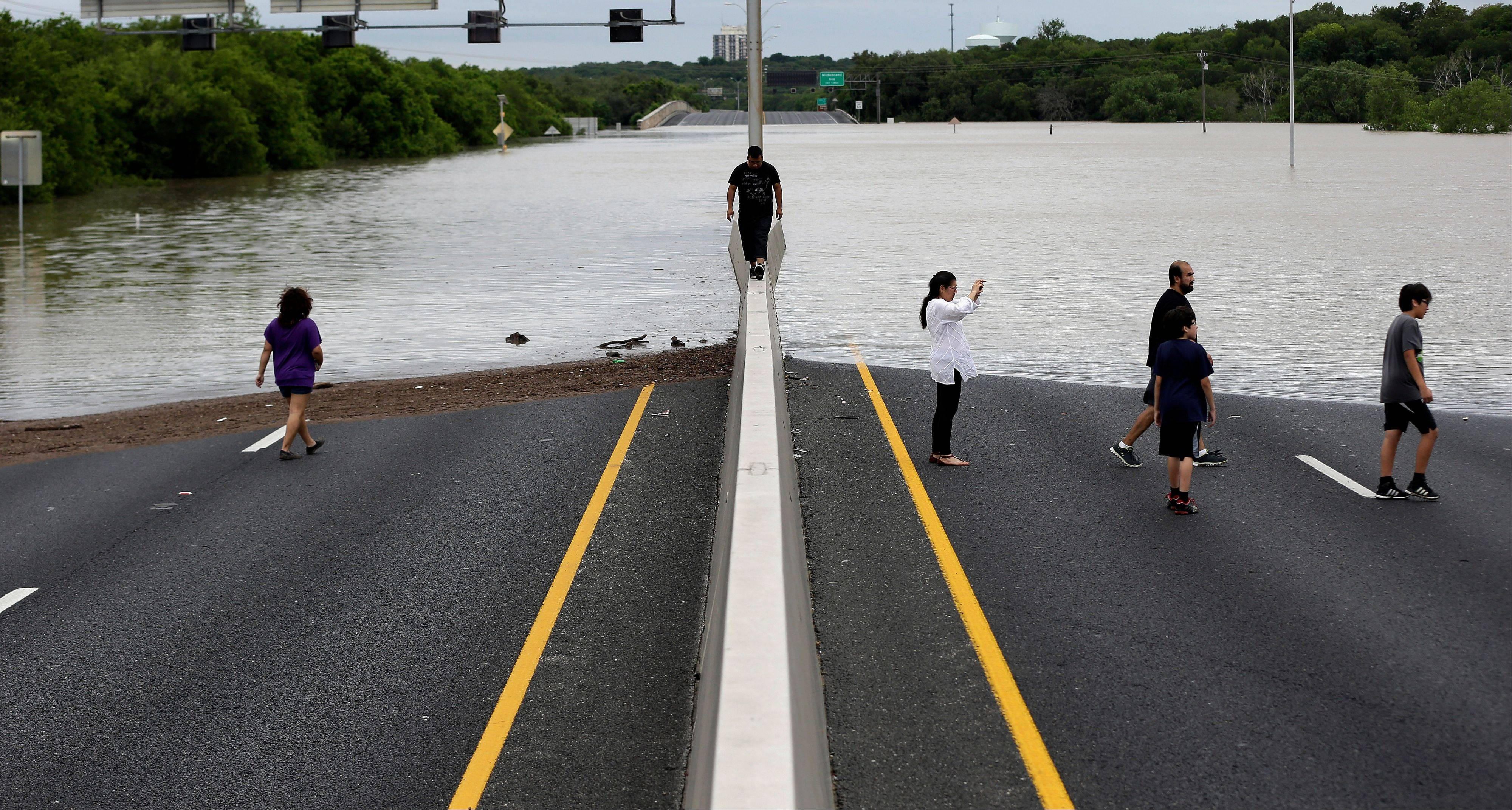Flood waters cover eight lanes of Highway 281.