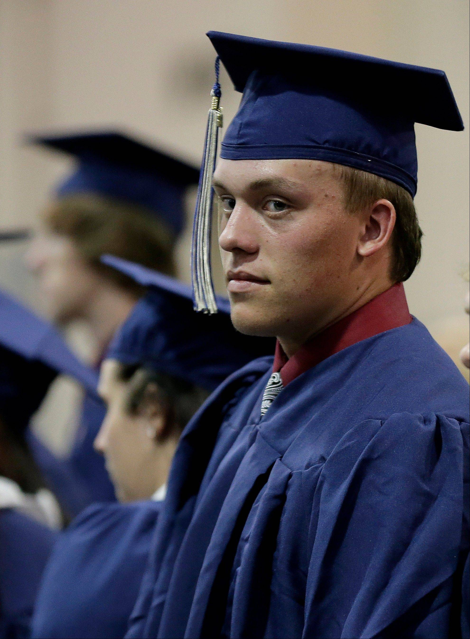Southmoore High School senior Jake Spradling waits with his classmates before their commencement ceremony Saturday in Oklahoma City.