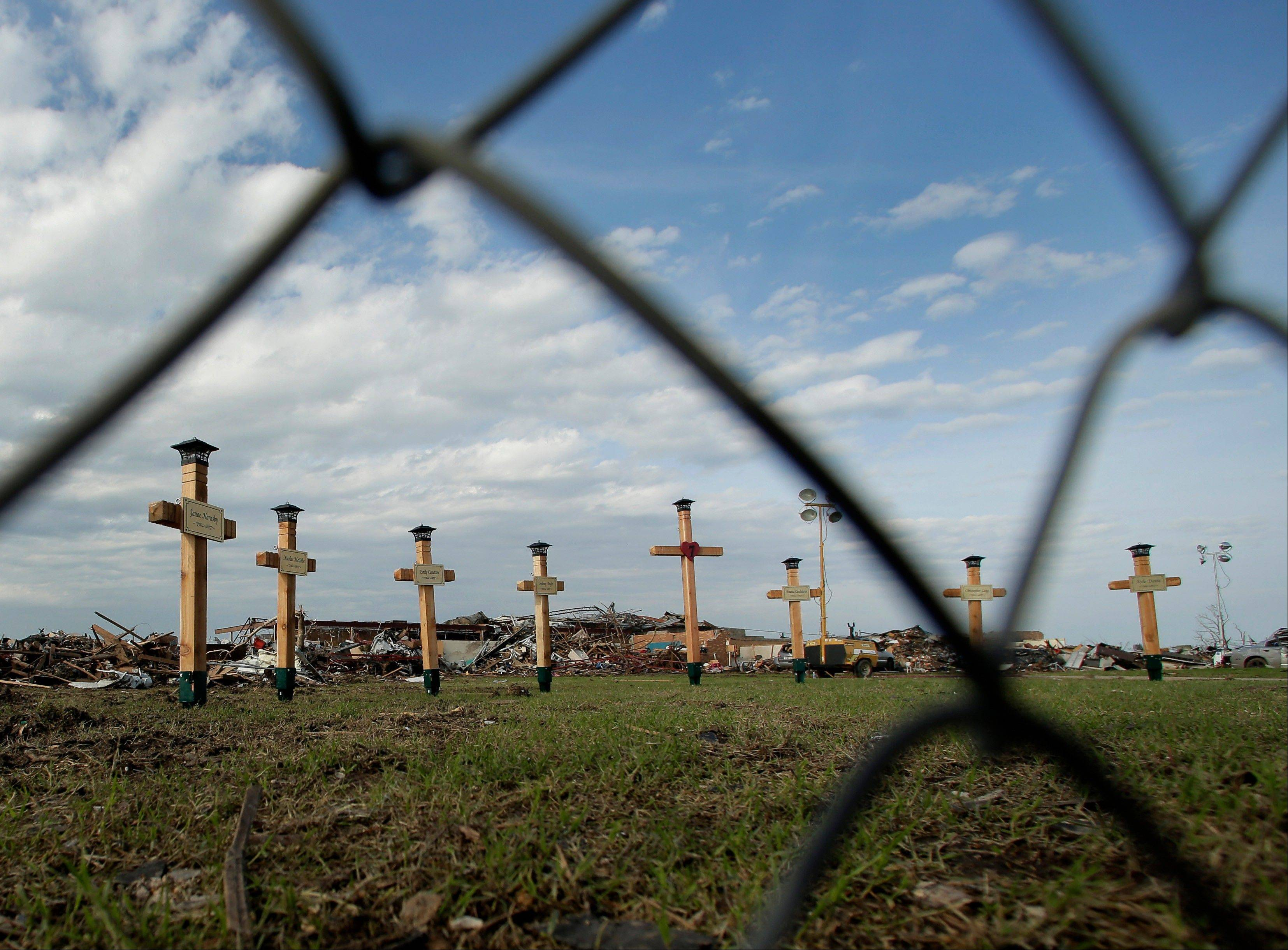 Crosses rise Saturday in memorial in front of Plaza Towers Elementary School where seven children were killed by Monday's tornado.
