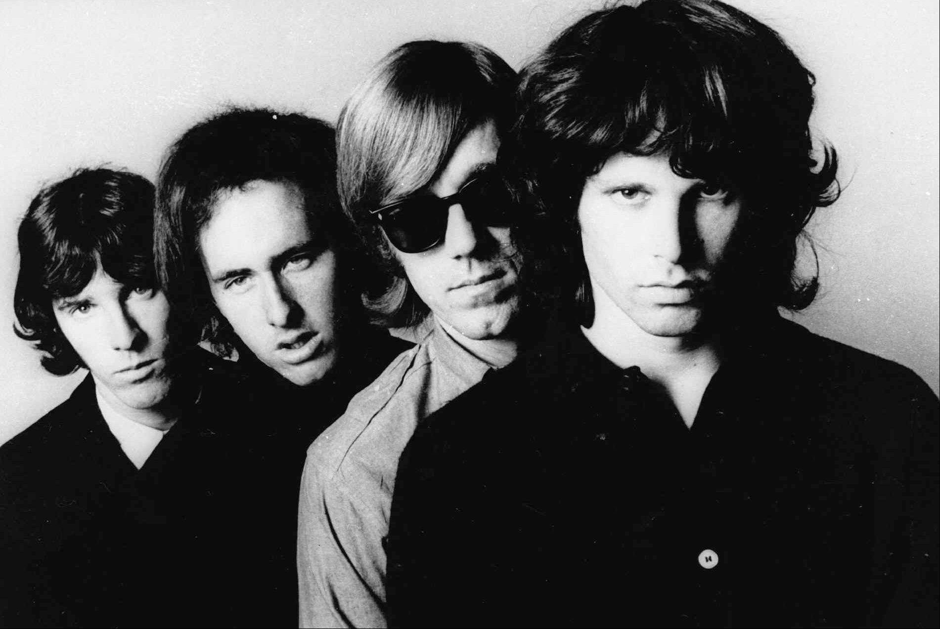 Members of the Doors, from left, John Densmore, Robbie Krieger, Ray Manzarek and Jim Morrison, pose for a portrait. Manzarek, the keyboardist who was a founding member of The Doors, has died at 74.