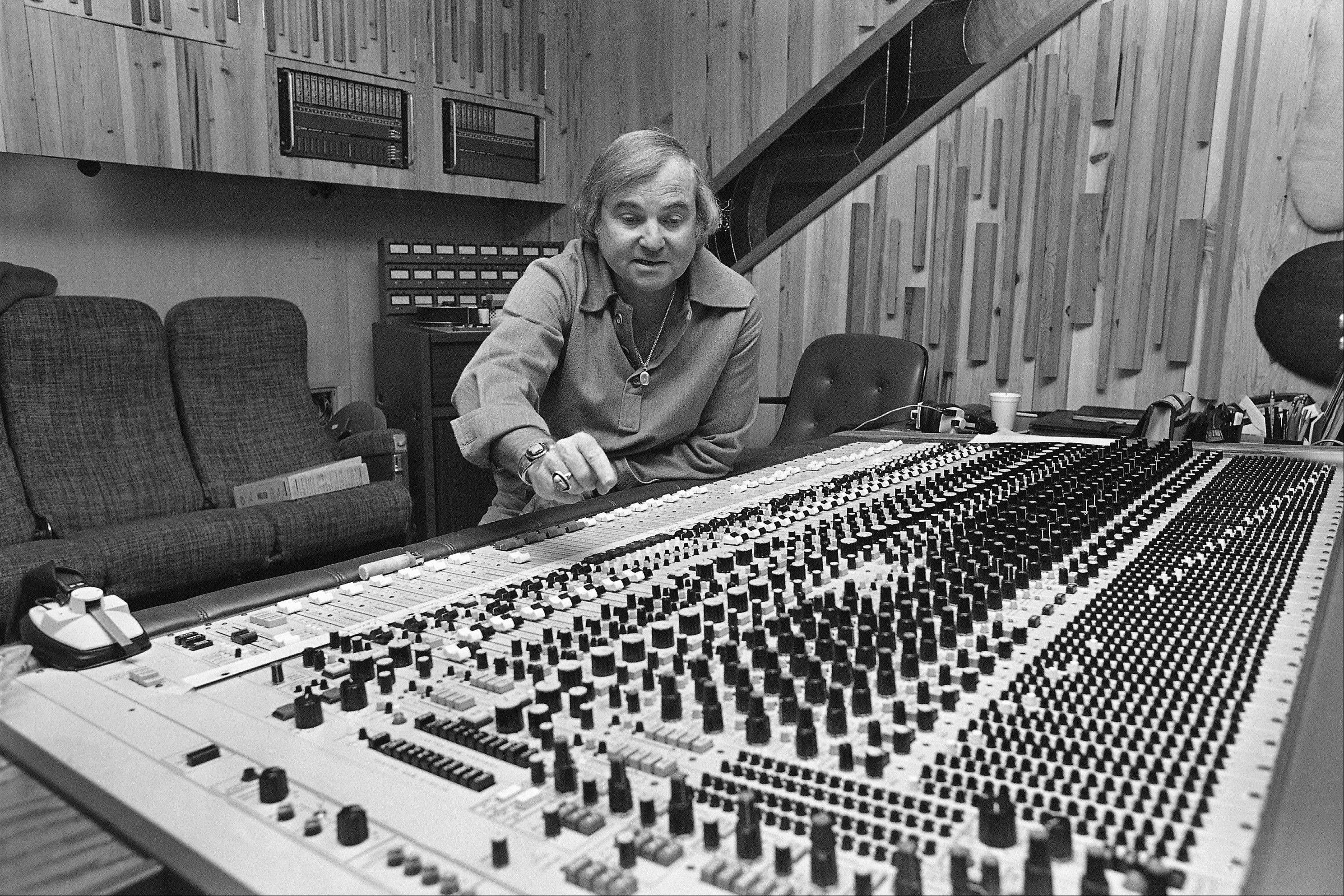 Mack Emerman, owner of Criteria Studios in Miami, points out one of the multitude of control knobs on a recording console.