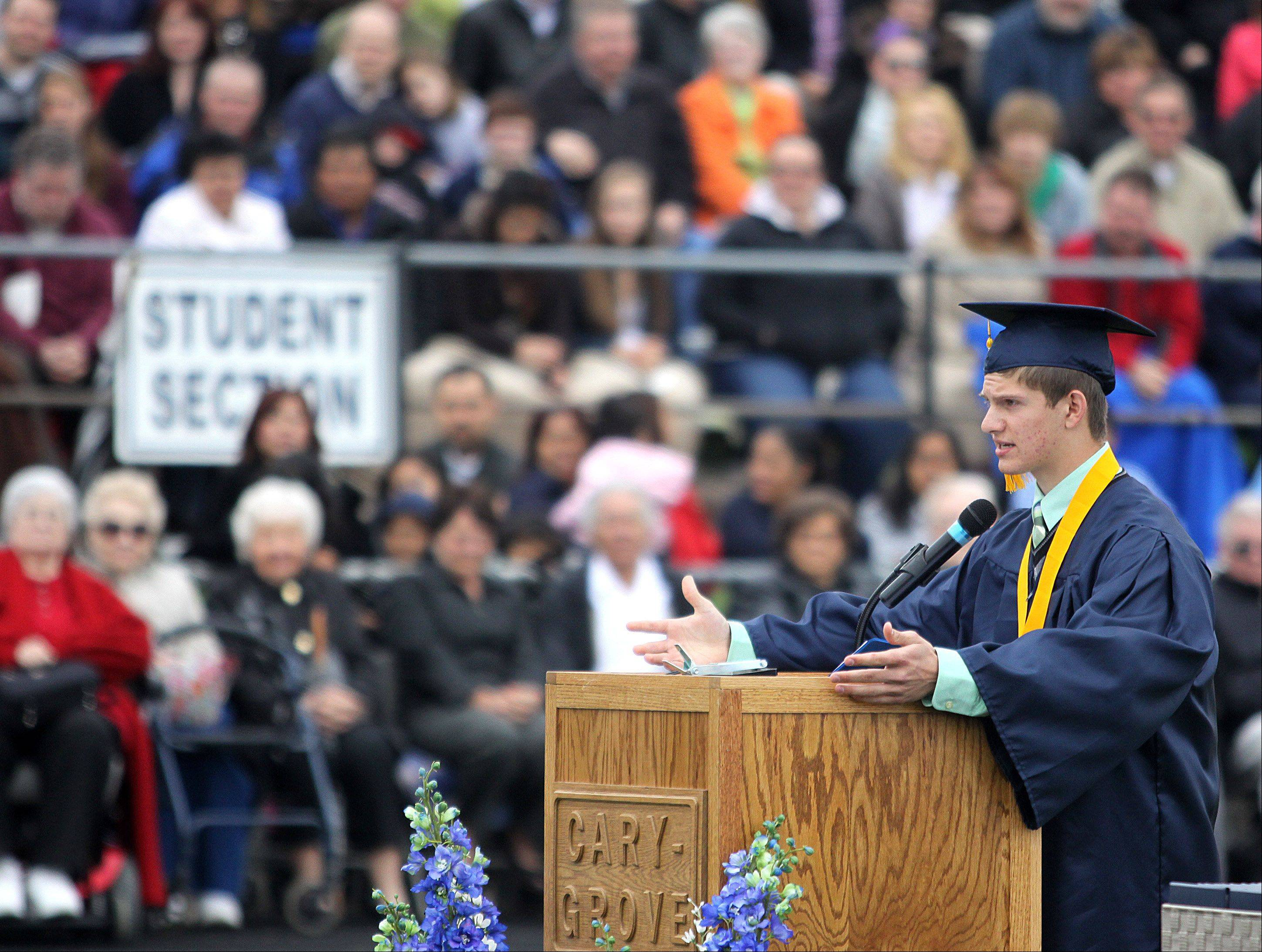 Class of 2013 Valedictorian Ryan DiCicco makes his address during Cary-Grove High School commencement exercises at Al Bohrer Athletic Field on the Campus of Cary-Grove High School on Saturday morning.