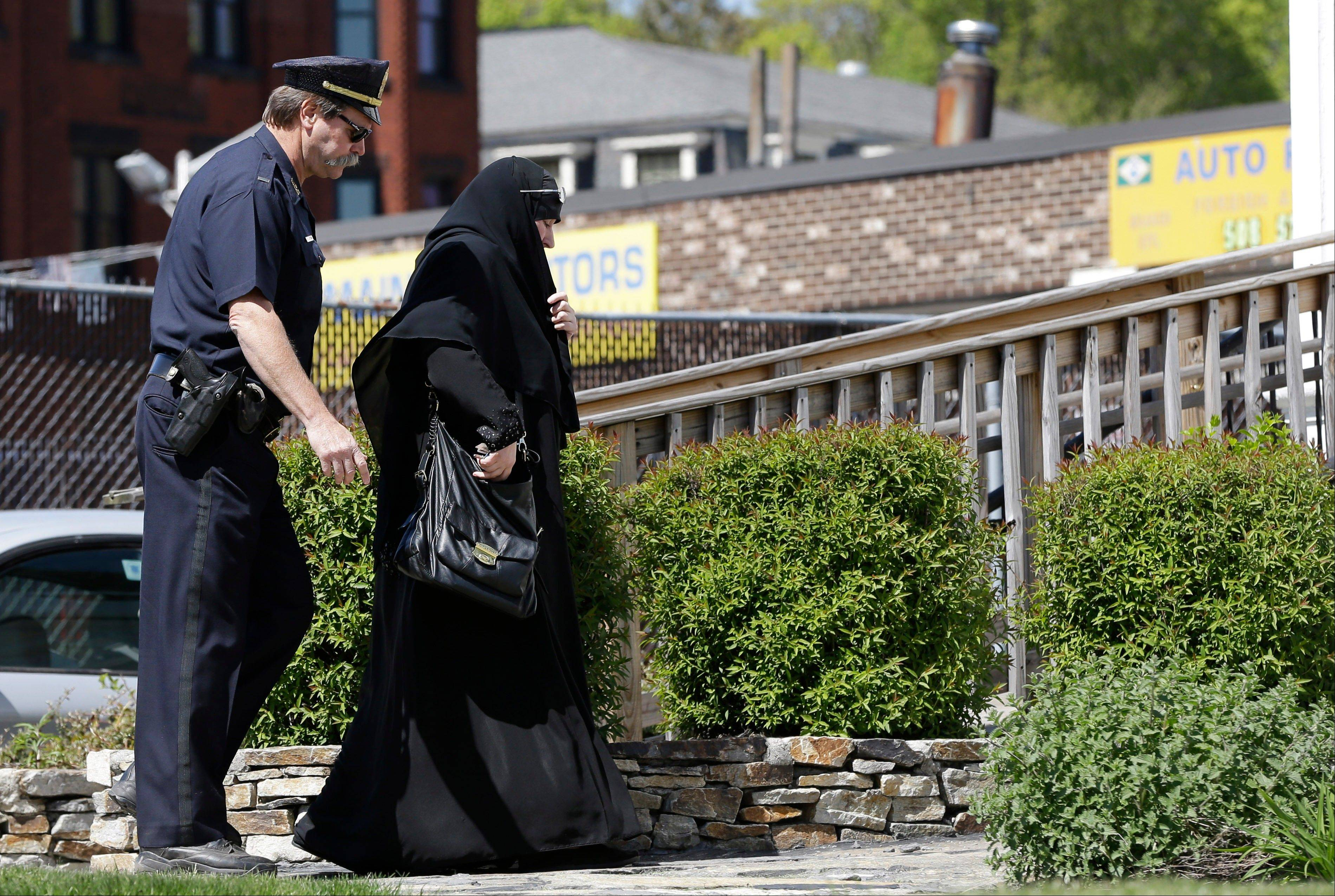 A police officer escorts a woman in Muslim dress to an entrance of the Graham, Putnam, at Mahoney Funeral Parlors in Worcester, Mass., where the body of slain Boston Marathon bombing suspect Tamerlan Tsarnaev is being prepared for burial. Within hours of the blasts at the Boston Marathon, government officials and members of Boston's Muslim community called each other to offer assistance. These calls were the fruits of years of cultivating relationships between the government and American Muslim communities, efforts made to ultimately prevent the very type of attack last month in Boston.