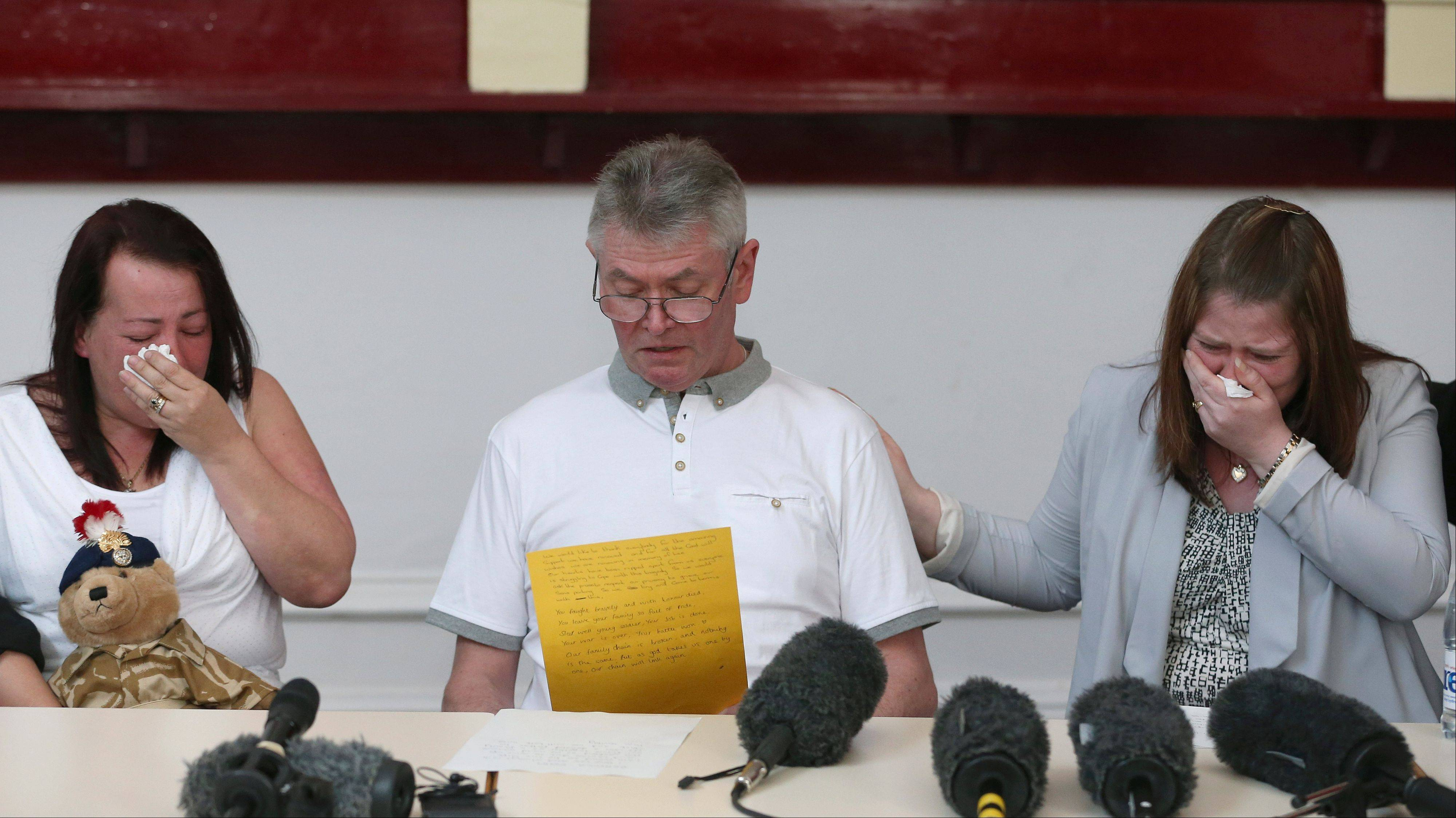 "Family members of murdered British soldier Lee Rigby, from left to right, his mother Lyn, stepfather Ian, and his wife Rebecca Rigby, as his stepfather reads a statement during a news conference at the Regimental HQ of his unit, the Royal Regiment of Fusiliers at Bury in Greater Manchester, England, Friday May 24. Ian Rigby thanked people for their support and including the tribute ""You fought bravely and with honor died."" Drummer Lee Rigby had served in Afghanistan and was attached to the Regimental Recruiting Team when he was hacked to death in broad daylight on Wednesday afternoon in Woolwich, southeast London. Two suspects were shot and arrested at the scene and remain in police custody."