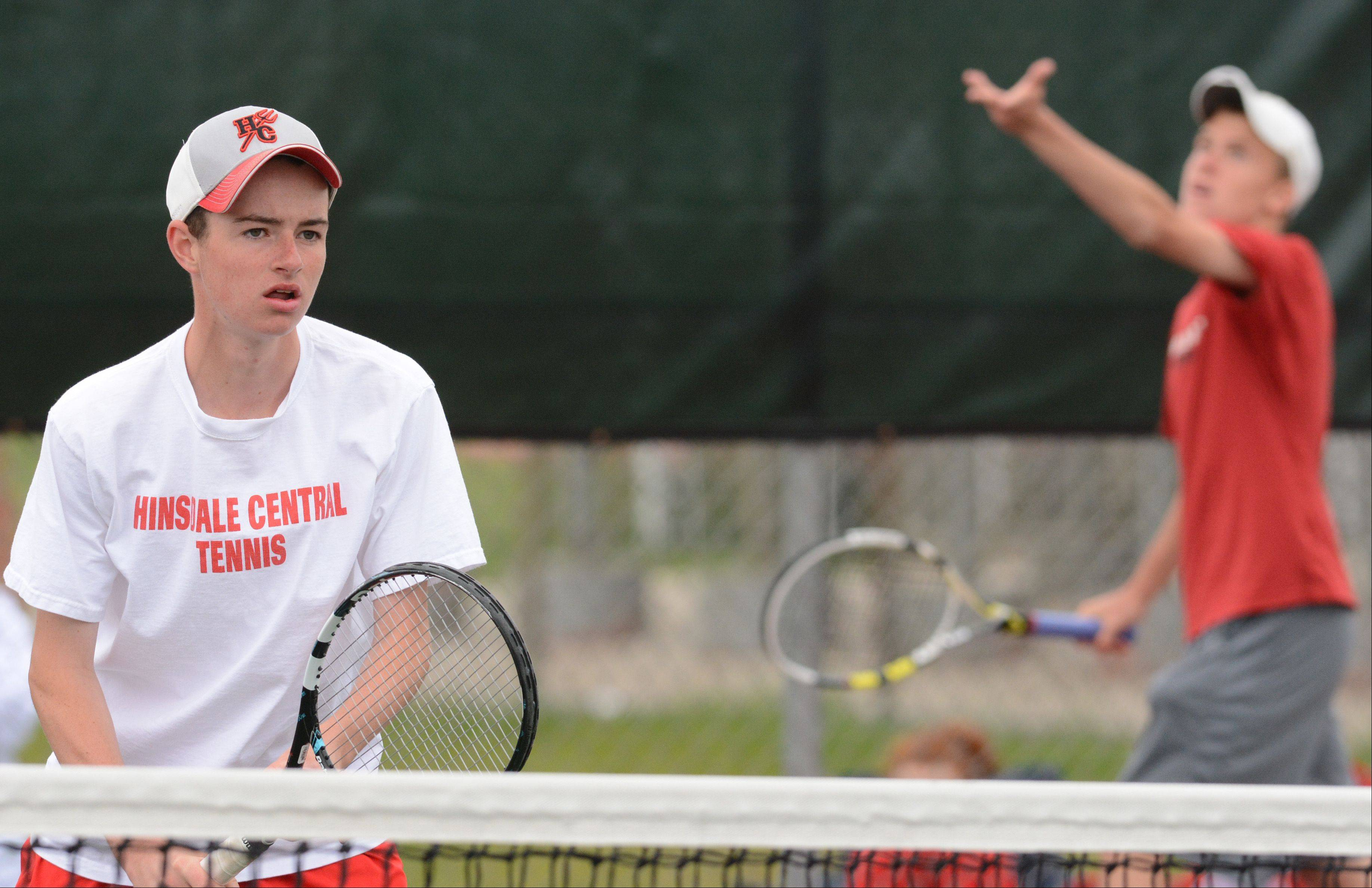 From left, eventual doubles champions Eddie Grabill and Harold Martin of Hinsdale Central compete at the boys tennis state tournament Saturday at Hersey.