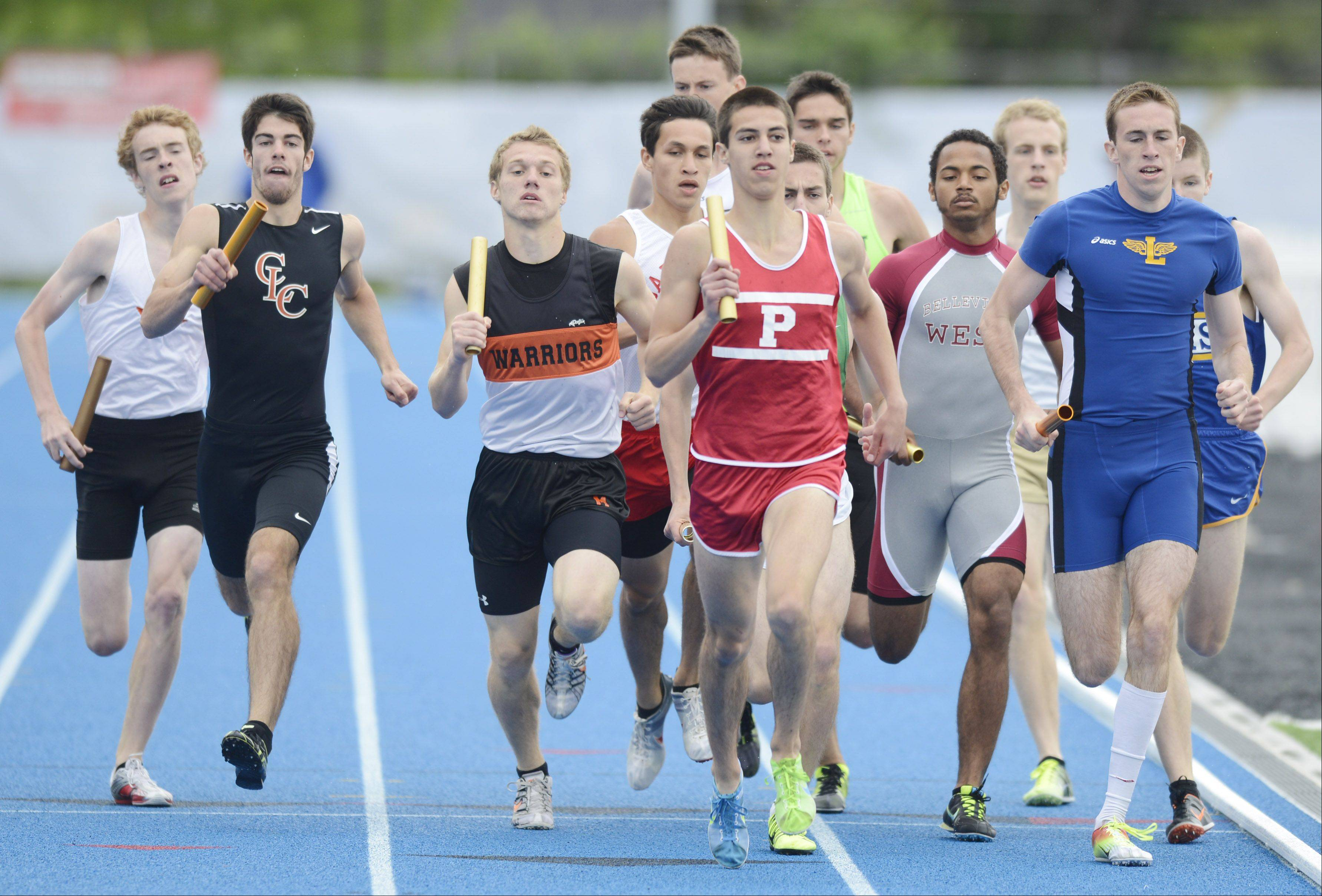 Palatine's Christian Zambrano, middle, is out front early in the Class 3A 4x800-meter relay during the boys track state finals in Charleston on Saturday.