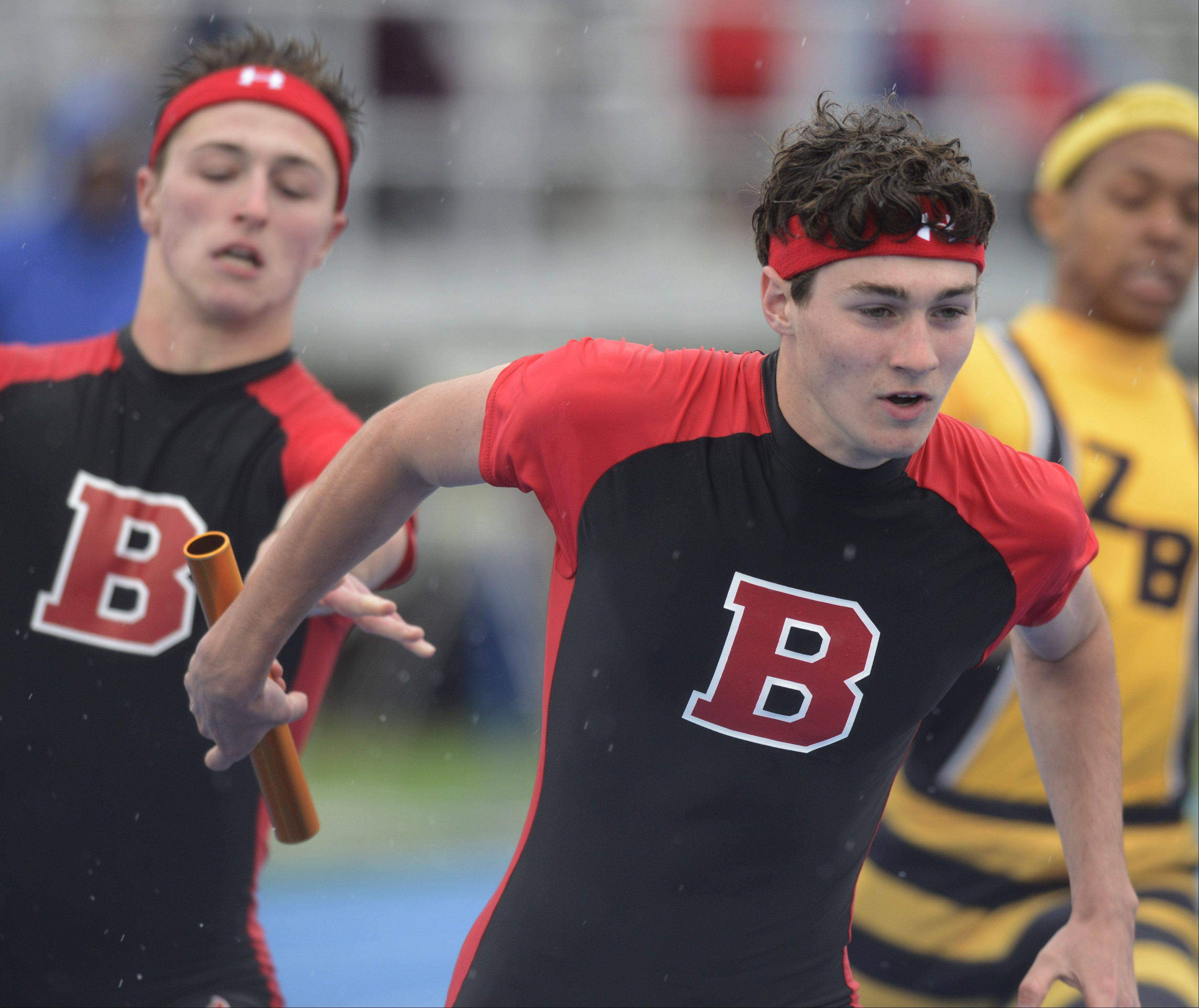 Barrington's Brandon Melynchuk takes the baton from teammate JP Brooks in the Class 3A 4x200-meter relay during the boys track state finals in Charleston on Saturday.