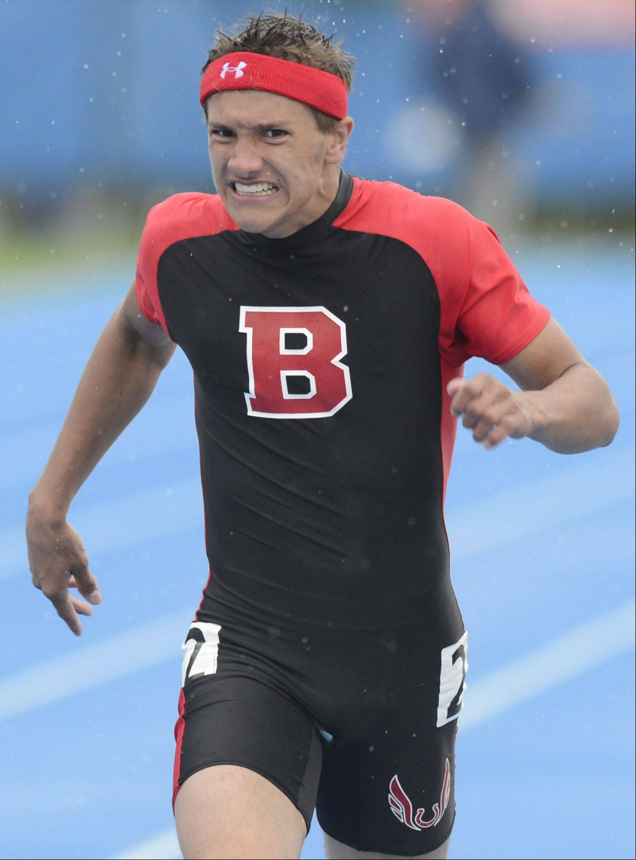 Barrington's Scotty Miller crosses the finish line in the Class 2A 200-meter dash during the boys track state finals in Charleston on Saturday.