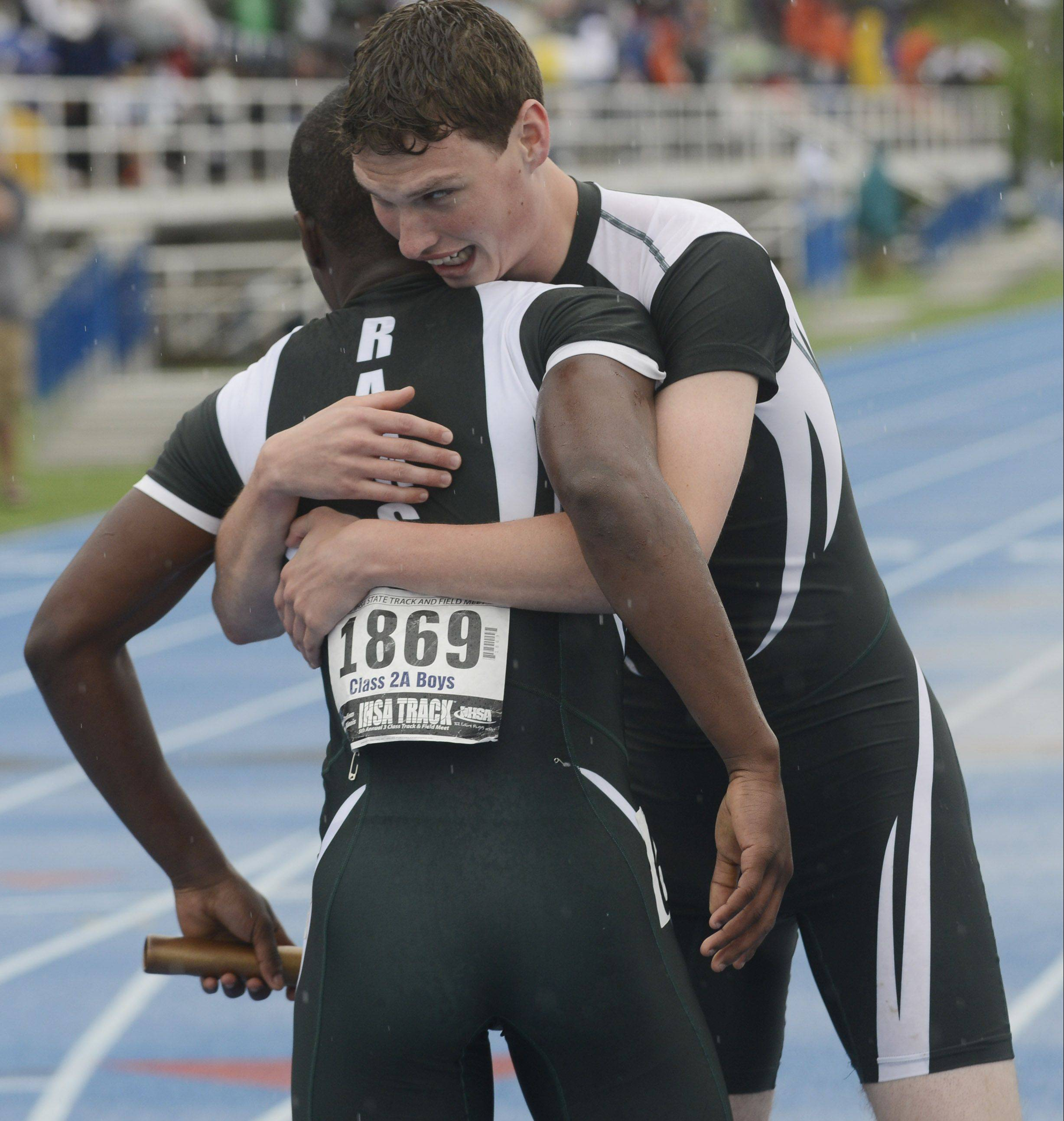 Grayslake Central's Matt Weatherhead, right, hugs teammate Dimitri Dawson at the finish line after the Rams won the Class 2A 4x200-meter relay during the boys track state finals in Charleston on Saturday.