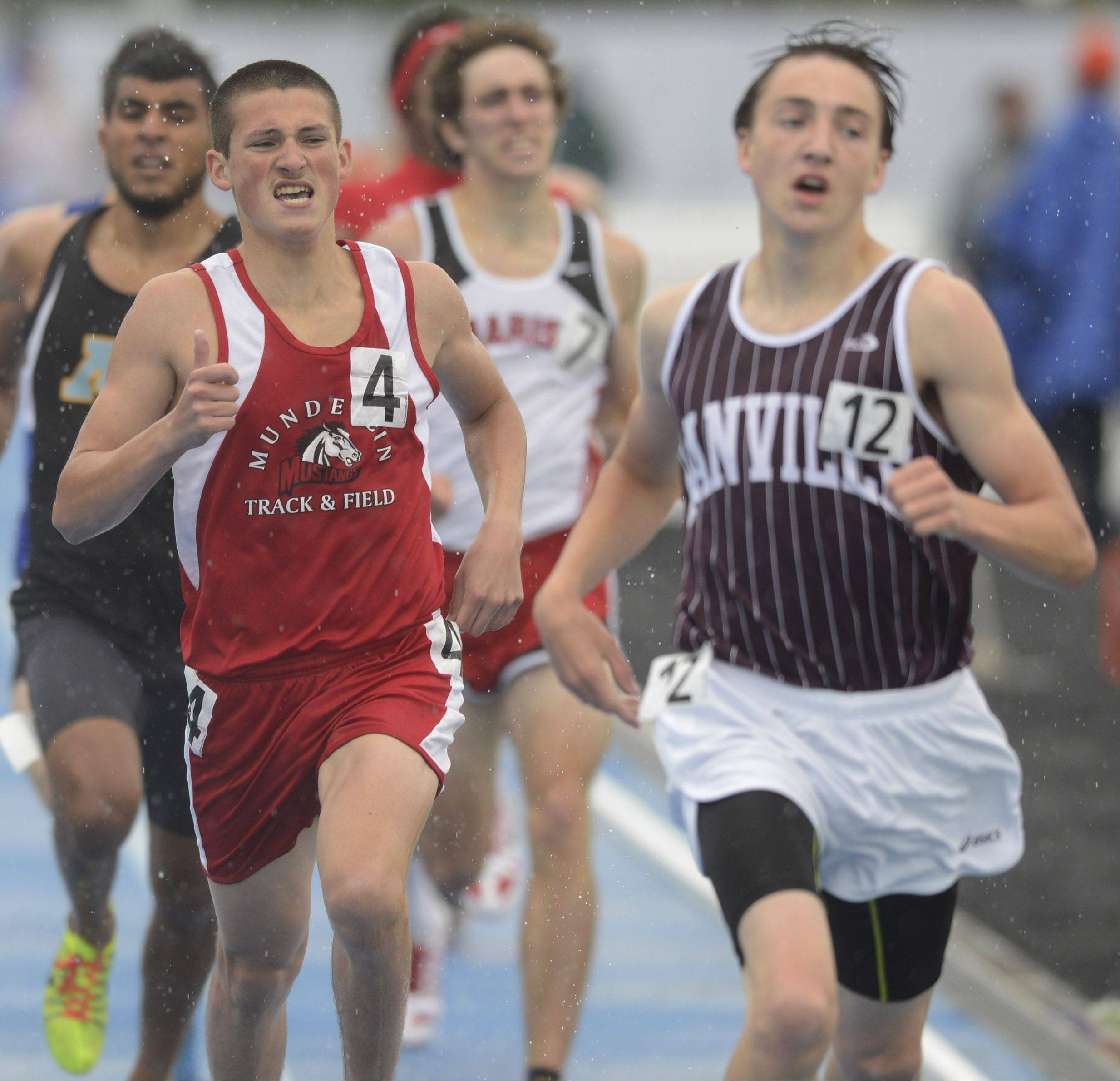 Mundelein's Bryce Richards finishes just behind winner Johnny Leverenz of Danville in the Class 3A 800-meter run during the boys track state finals in Charleston on Saturday.