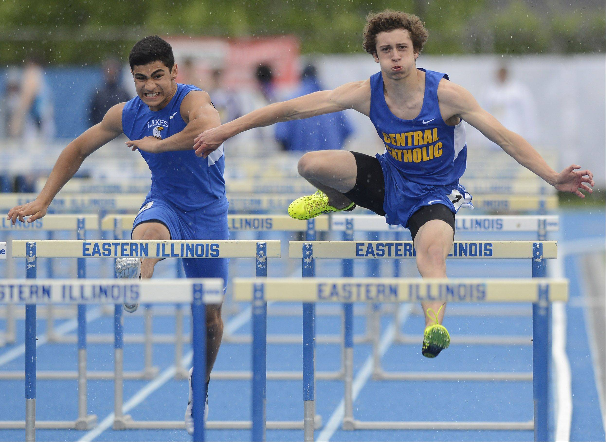 Rodolphe Boyer, left, of Lakes, and Patrick Lefevre of Aurora Central Catholic run alongside each other in the Class 2A 110-meter high hurdles during the boys track state finals in Charleston on Saturday.